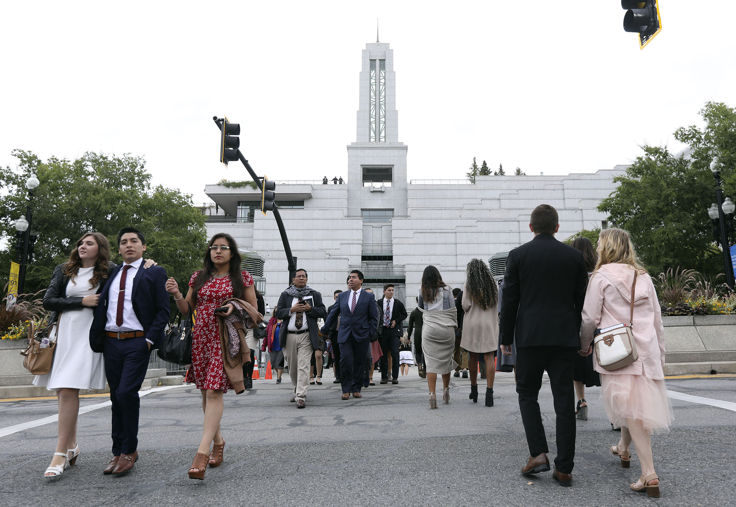 People walk between Temple Square and the Conference Center between sessions of the 188th Semiannual General Conference of The Church of Jesus Christ of Latter-day Saints in downtown Salt Lake City on Sunday, Oct. 7, 2018.