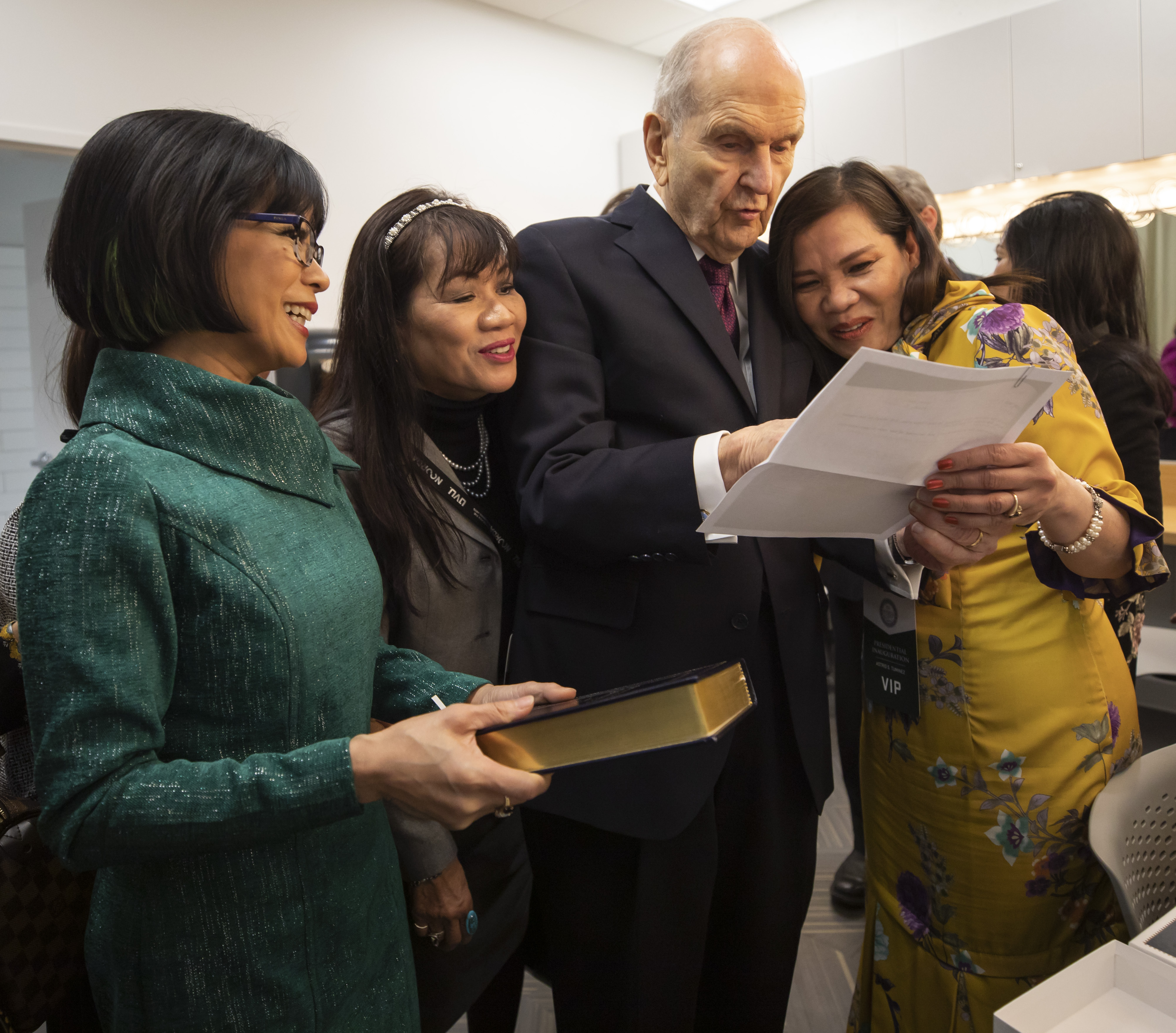 President Russell M. Nelson reviews over surgical documents with Nora Olson, sister of UVU President Astrid Tuminez. Decades ago, Dr. Russell M. Nelson performed heart surgery on Olson. At left are President Tuminez and her sister, Julie Ludlow. President Nelson met with the sisters at the Presidential Inauguration in the Concert Hall of the Noorda Center for the Performing Arts, on the Campus of Utah Valley University in Orem, Utah Wednesday, March 27, 2019.