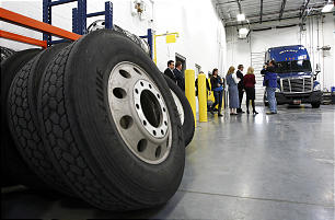 Members of the media tour the vehicle maintenance facility of the new Utah Bishops' Central Storehouse in Salt Lake City, Thursday, Jan. 26, 2012.