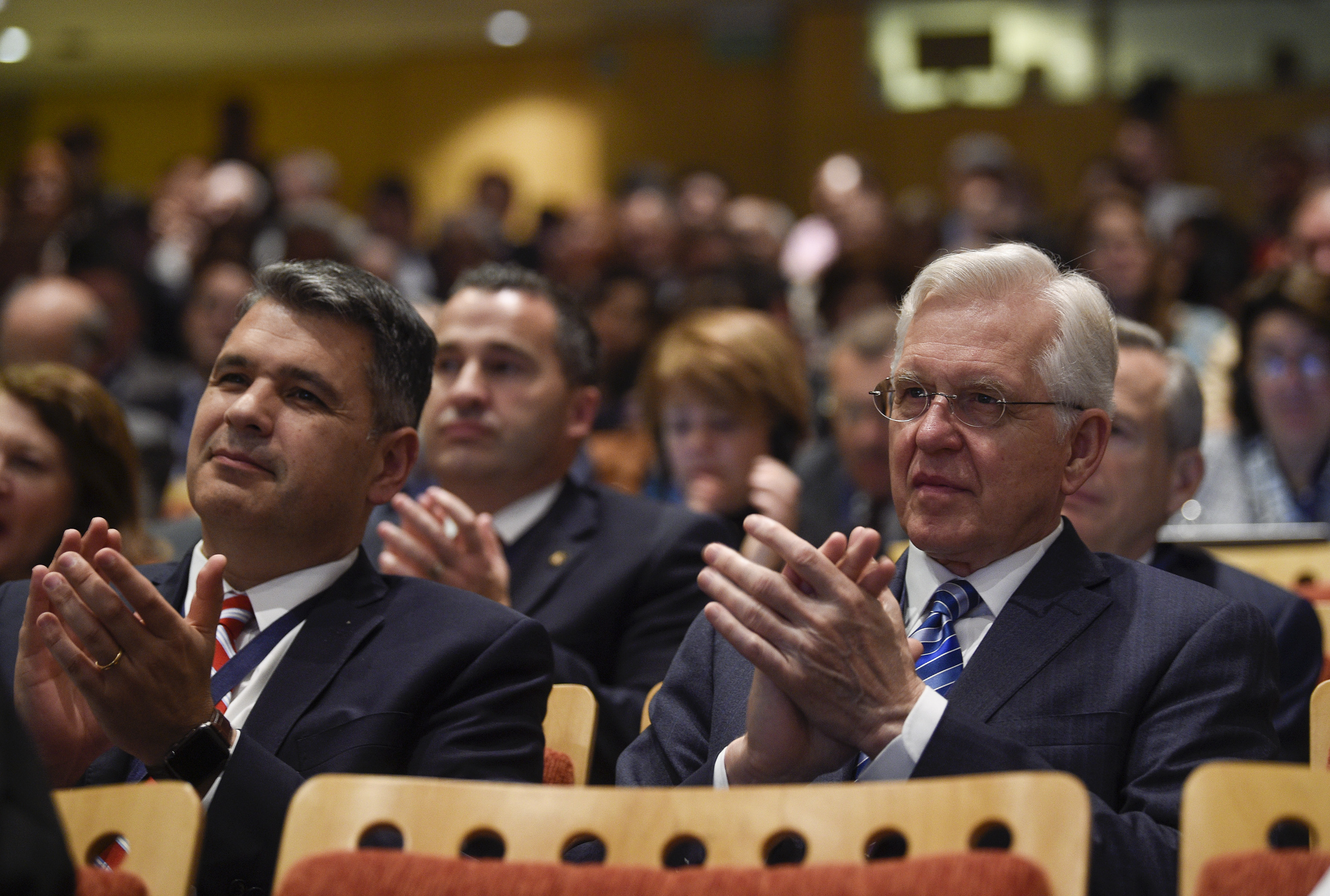 Elder D. Todd Christofferson of the Quorum of the Twelve Apostles, right, applauds during the G20 Interfaith Forum in Buenos Aires, Argentina, on Wednesday, Sept. 26, 2018.