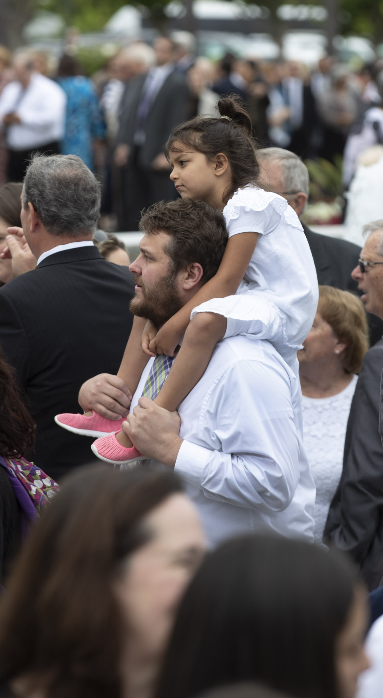 Sabraya Gorham rides on her father, Matthew Gorham's shoulders as she waits for her mother, Avalika Gorham, to come out of the Oakland California Temple where President Dallin H. Oaks, first counselor in the First Presidency, rededicated the building on Sunday, June 16, 2019.