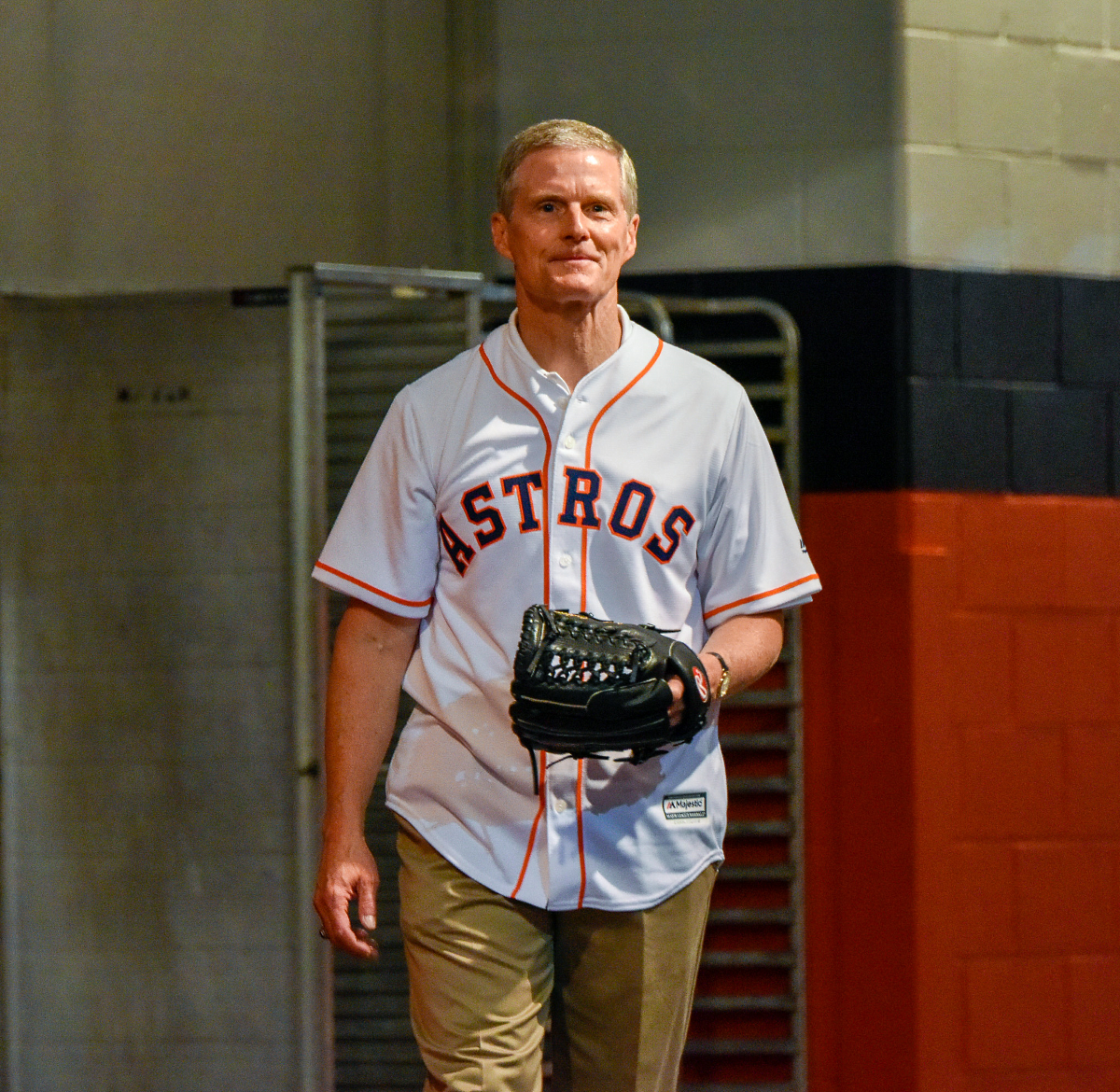 Elder David A. Bednar of the Quorum of the Twelve Apostles prepares for throwing the ceremonial first pitch at Minute Maid park.