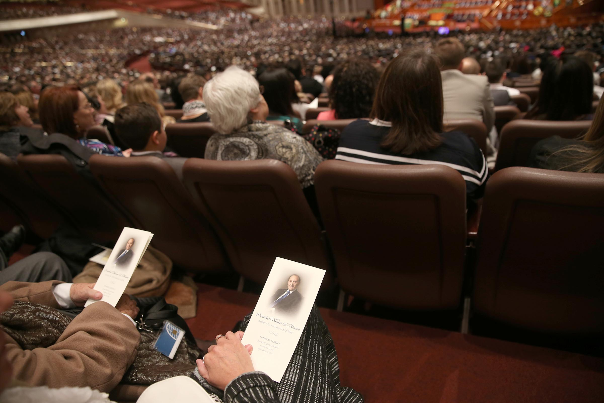 Mourners listen during President Thomas S. Monson's funeral at the Conference Center in Salt Lake City on Friday, Jan. 12, 2018.