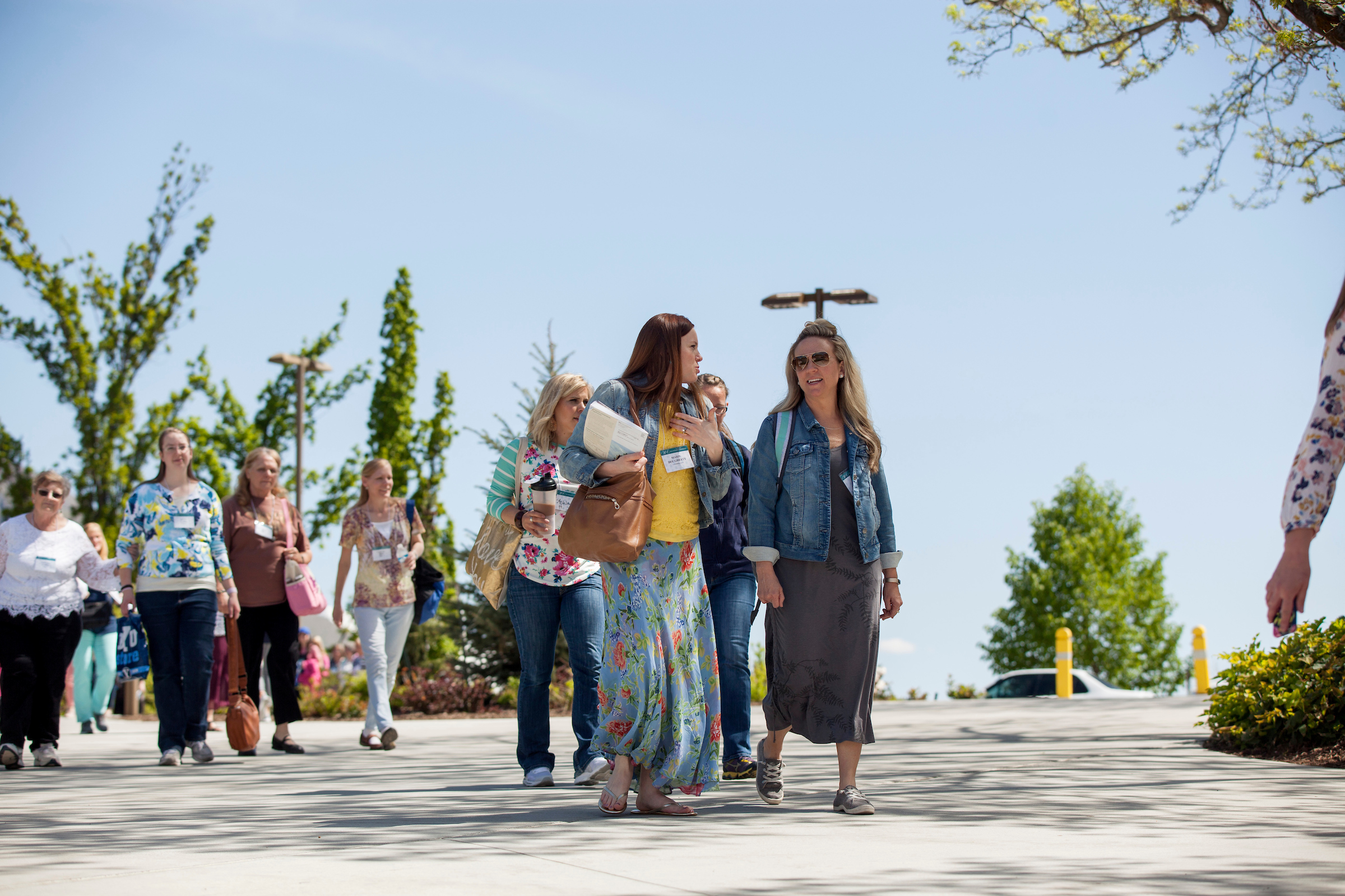 Women walk towards the Marriott Center during BYU Women's Conference on May 4, 2018.