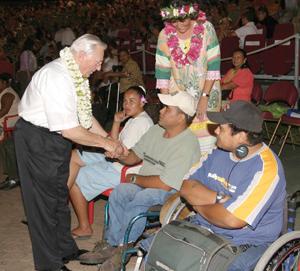 Elder Robert K. Dellenbach, president of Pacific Islands Area, greets members during celebration in Tahiti.