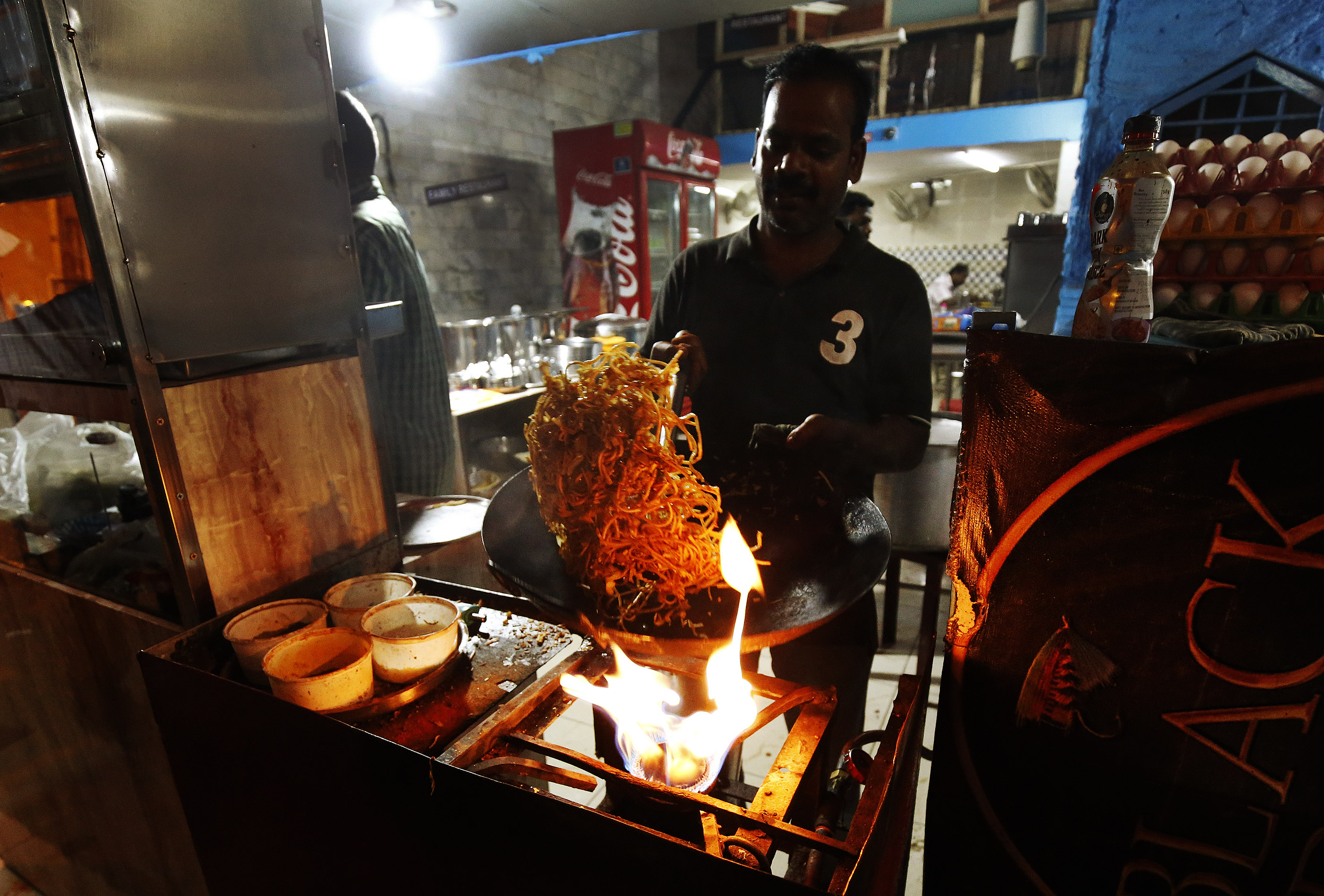 A street vendor cooks in Bengaluru, India, on Thursday, April 19, 2018.