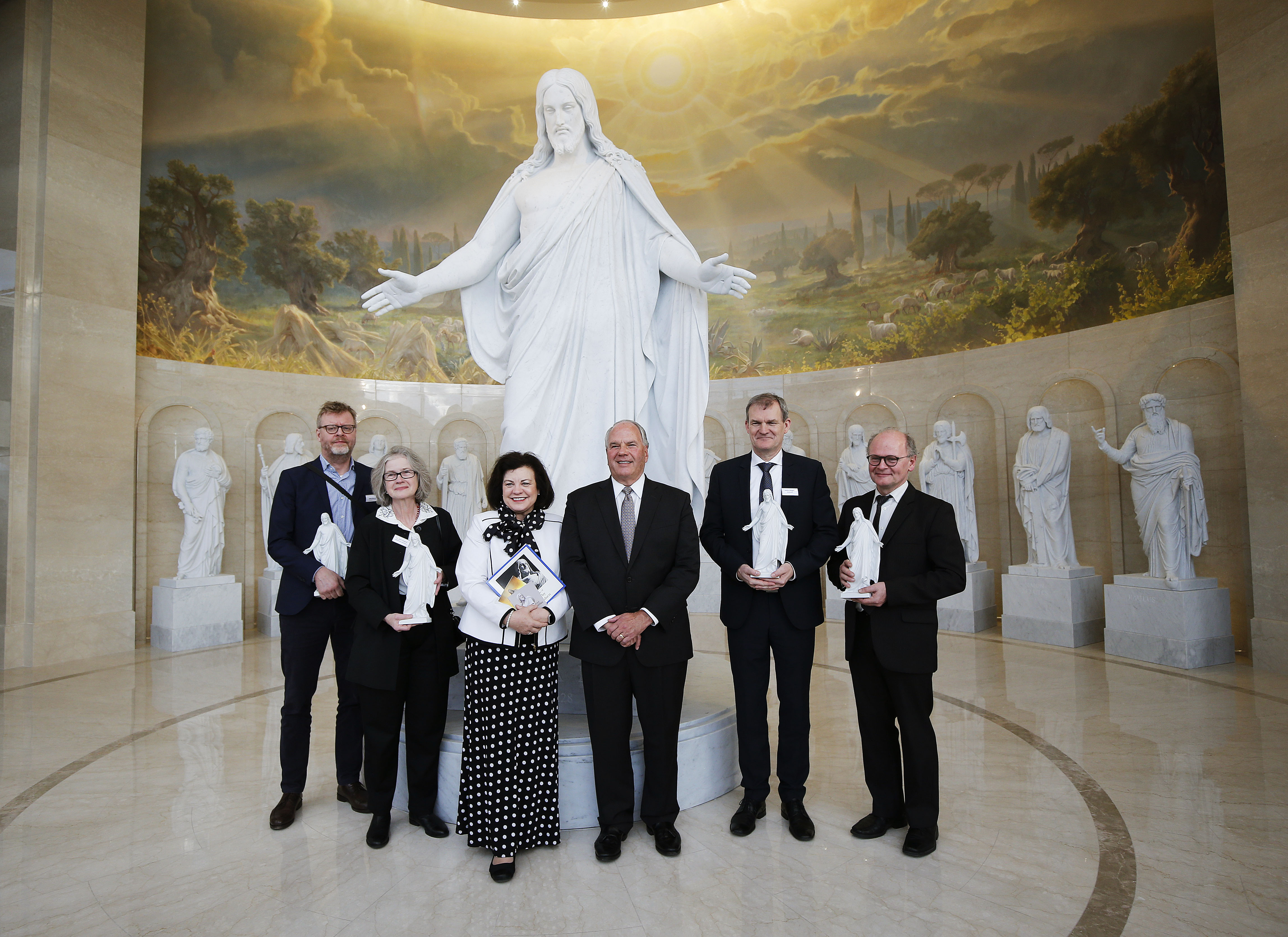 Elder Ronald A. Rasband, center, of the Quorum of the Twelve Apostles poses with officials from the Church of Our Lady in Denmark, which is home to the original Christus statue, after giving them a tour at the Rome Temple Visitor's Center and presents of Christus figurines in Rome on Wednesday, Jan. 16, 2019.