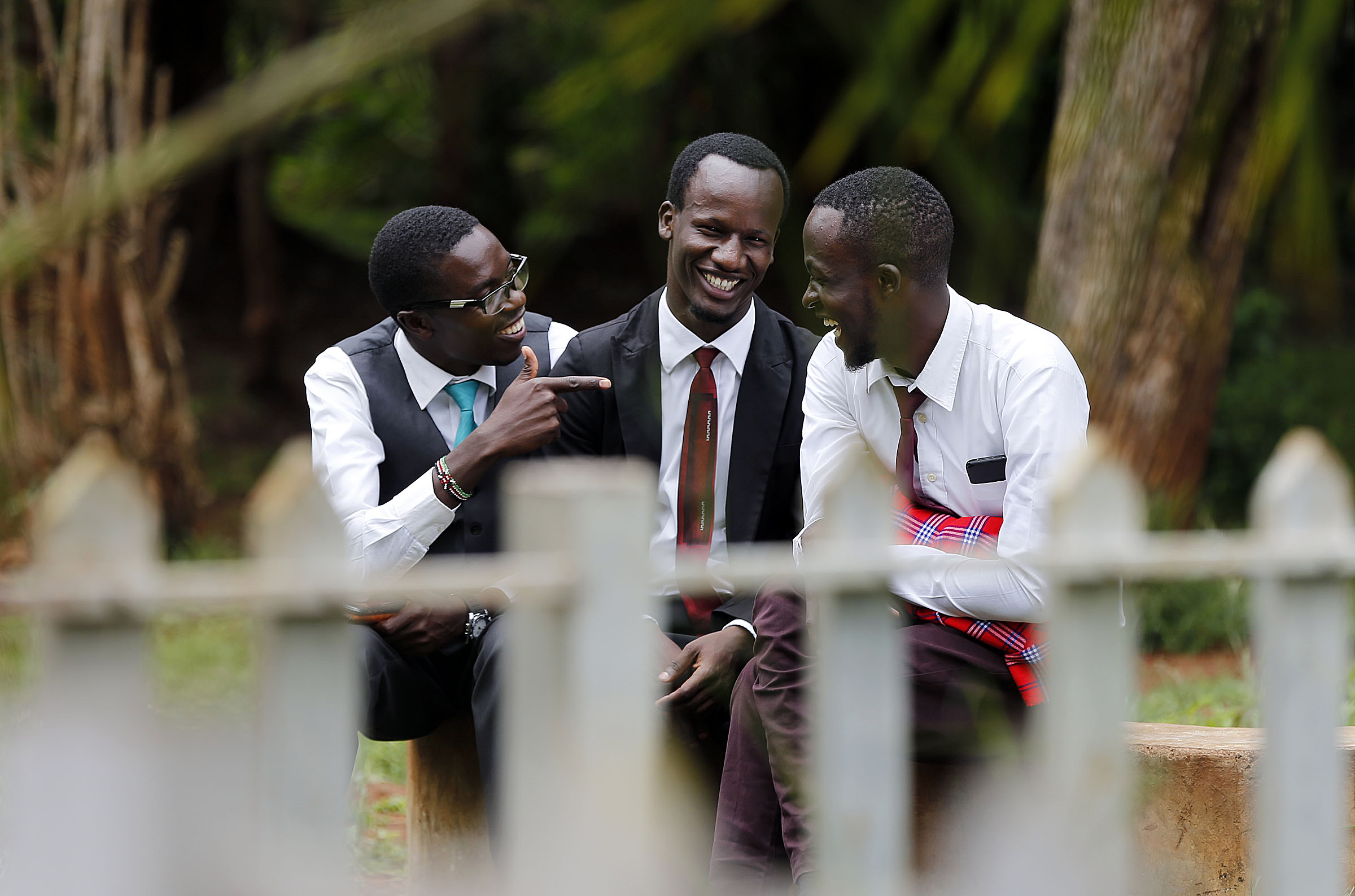 Righton Lukalo Mutasi, left, Bbosa Joseph Malusi and Kennedy Nzuki talk before a special devotional with President Russell M. Nelson in Nairobi, Kenya, on Monday, April 16, 2018.