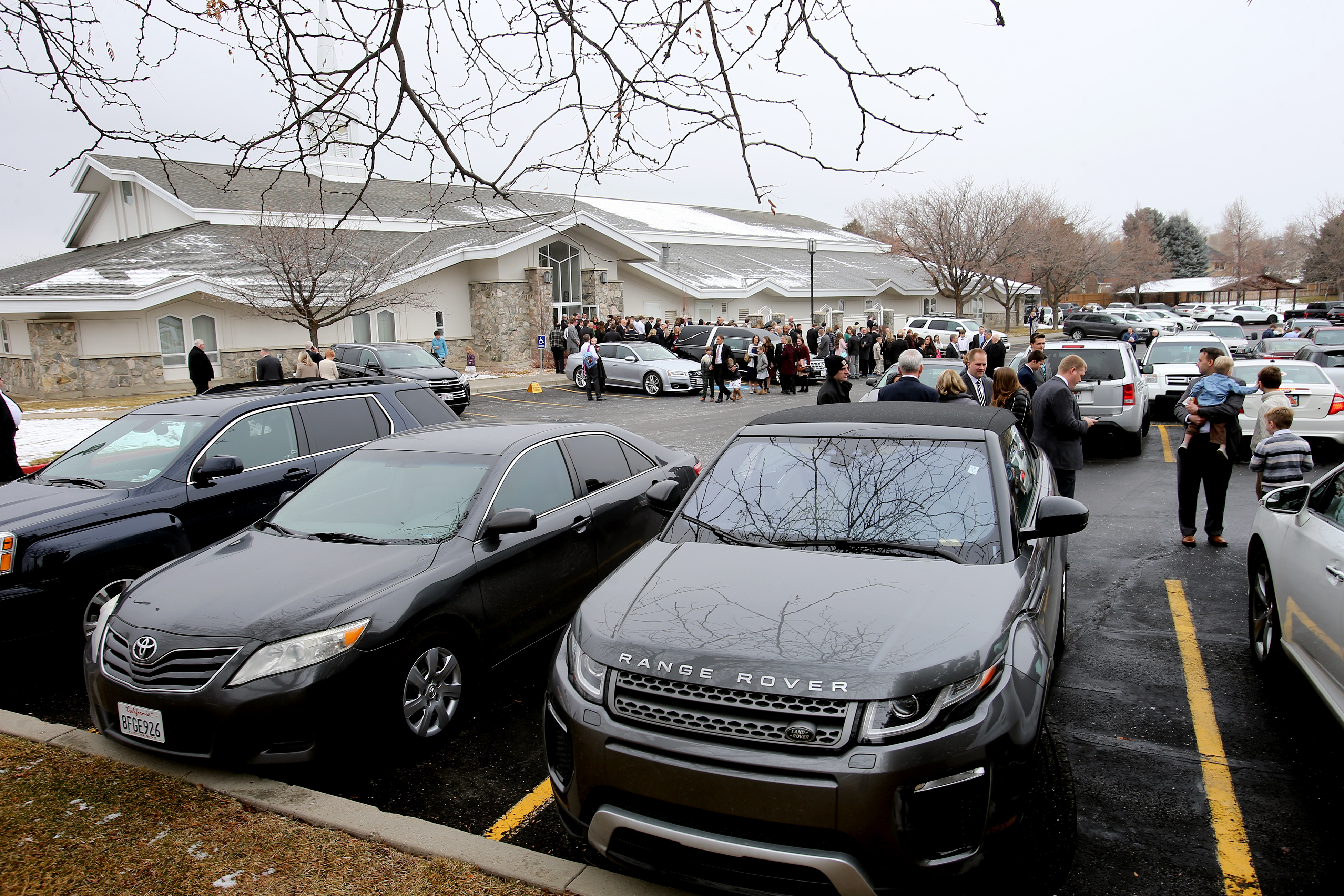Family and friends exit theCottonwood Heights Utah Brighton Stake Center after funeral services for Wendy Nelson Maxfield on Saturday, Jan. 19, 2019.