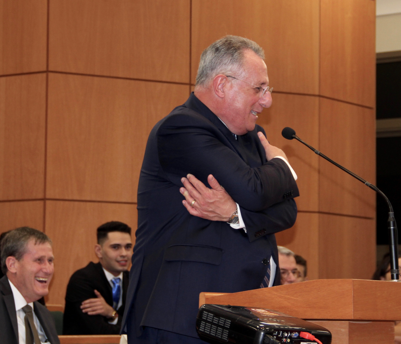 "Apologizing that he would be unable to personally greet each young member attending the June 1, 2019, youth devotional in Fortaleza, Brazil, Elder Ulisses Soares shows he is giving attendees a ""virtual embrace."""
