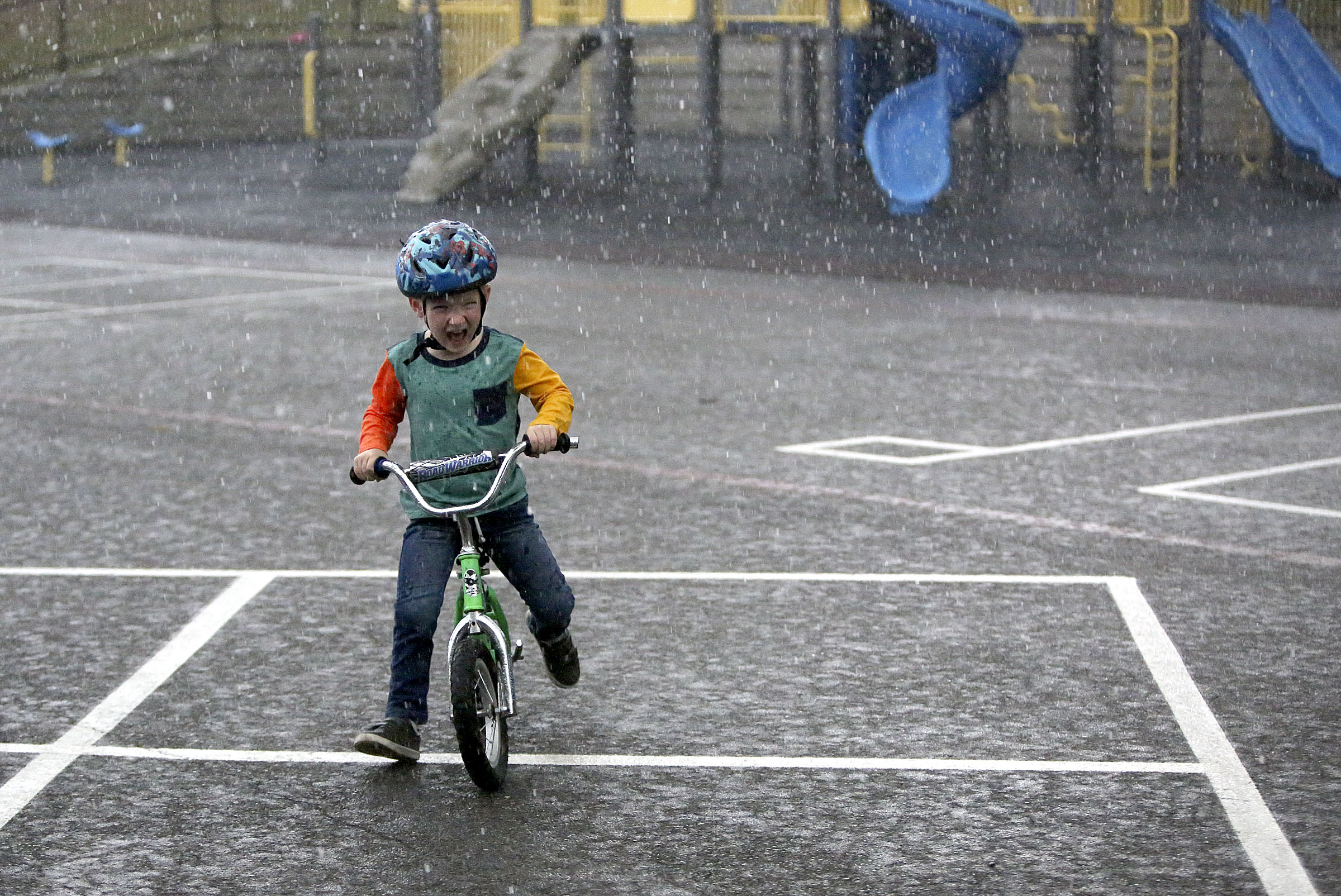 Daniel Allen gets caught in a rain storm near his home in Renton, Wash., on Friday, Sept. 14, 2018.