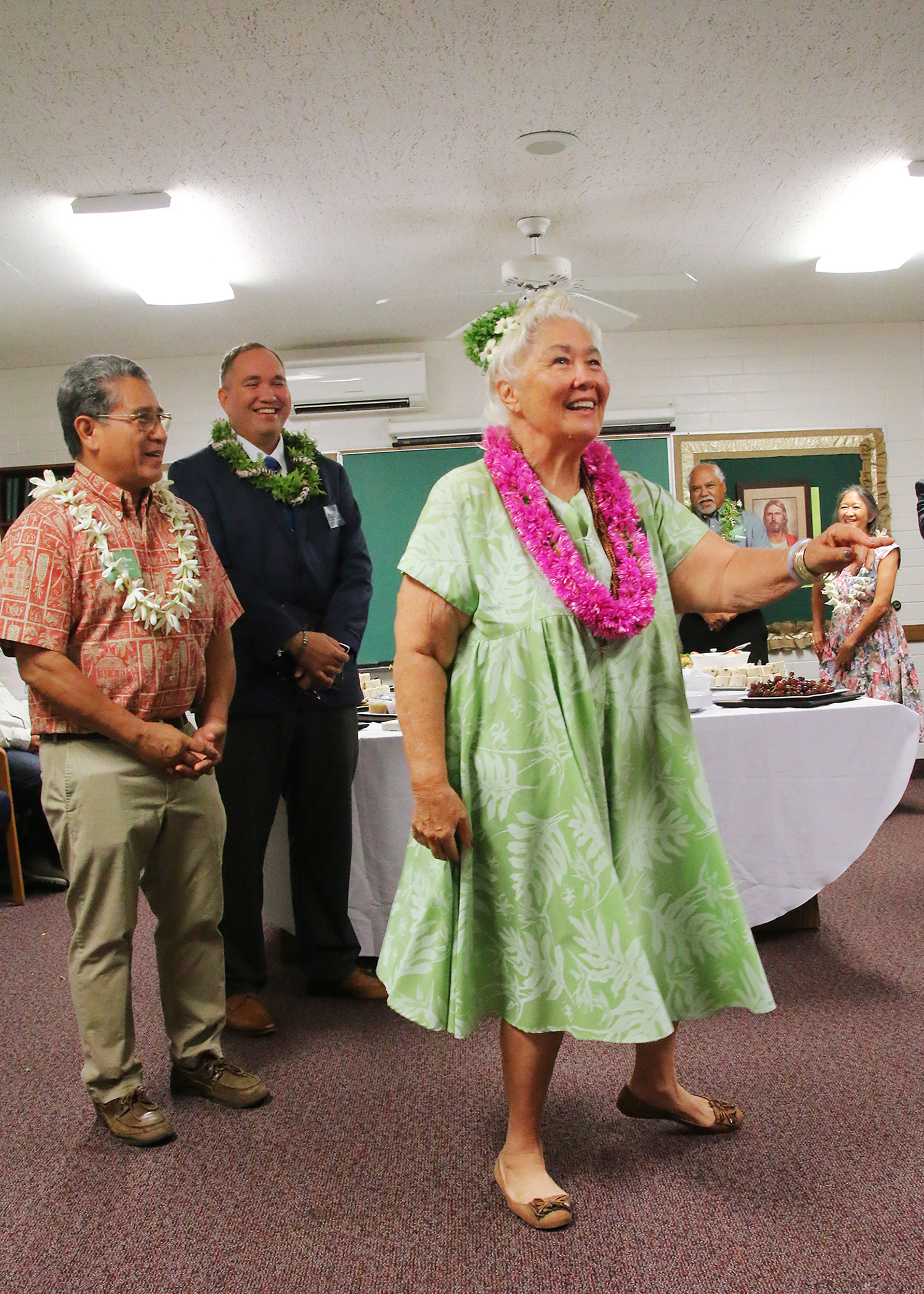Ulalia Ka'ai Berman — a revered kumu hula (hula master), Hawaii studies teacher in Kona and an active Catholic — dances an impromptu hula for President Nelson and his party during a special reception for community leaders before his May 16, 2019, devotional in the Kona Hawaii Stake center. She is accompanied vocally by the Rev. Danny Akaka Jr., left, son of Hawaii's late U.S. Sen. Daniel Akaka and himself a well-known Hawaiian entertainer, historian and storyteller; and Lono Ikuwa, second from left, a Latter-day Saint.