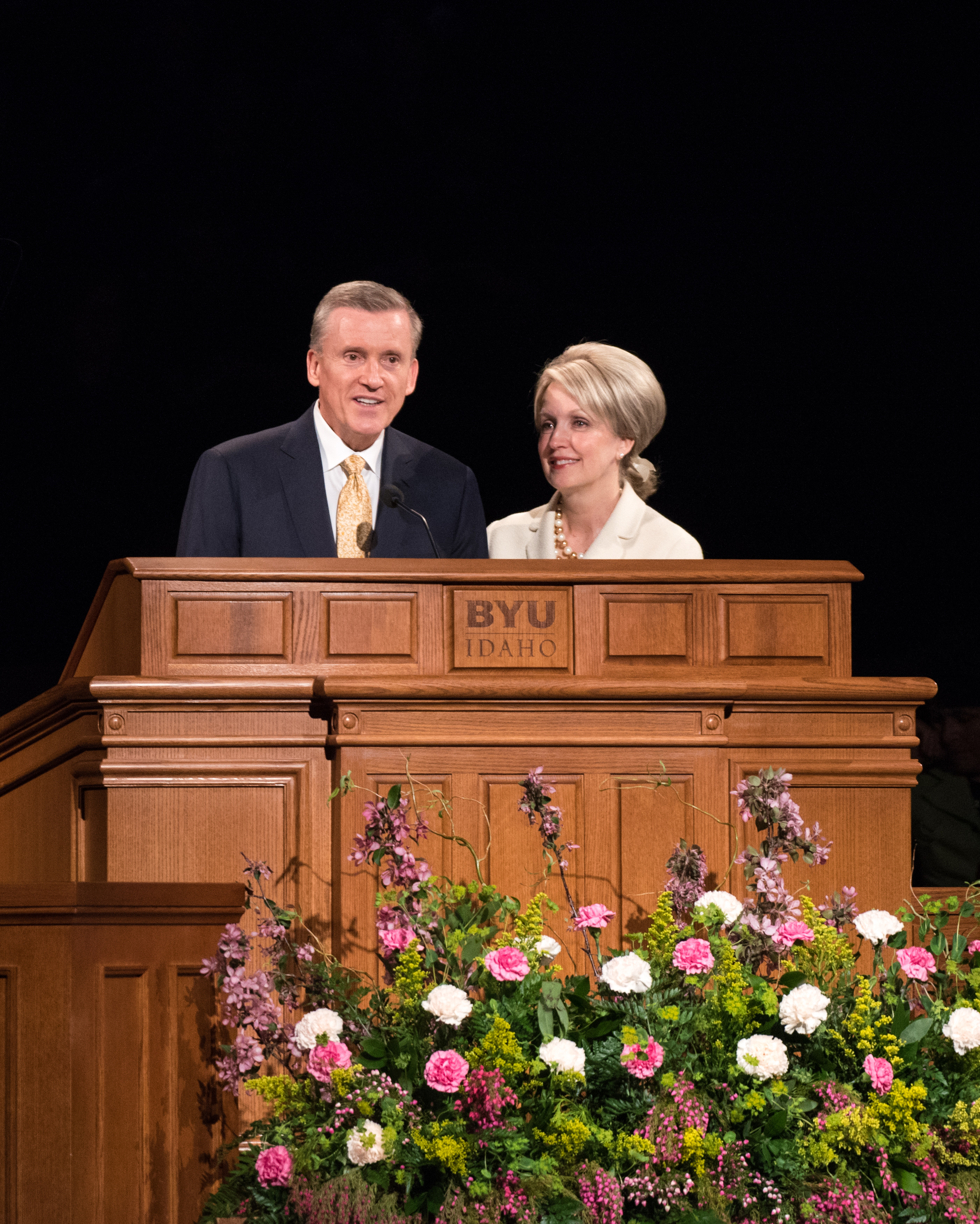 Elder Kevin R. Duncan, and his wife Sister Nancy Duncan, address students at a BYU-Idaho Devotional on May 21, 2019.