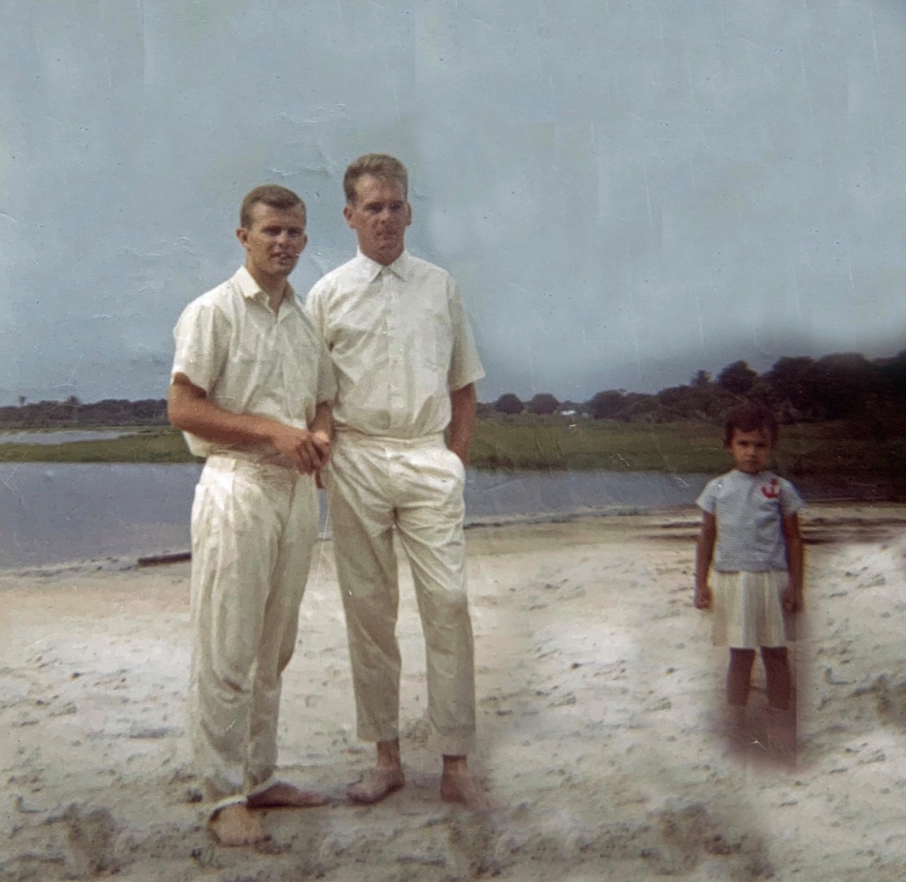 Elder John Beck, left, and Carlos Cintra, middle, stand at the edge of Lake Messejana in Fortaleza, Brazil, prior to the latter's baptism on Dec. 31, 1966.