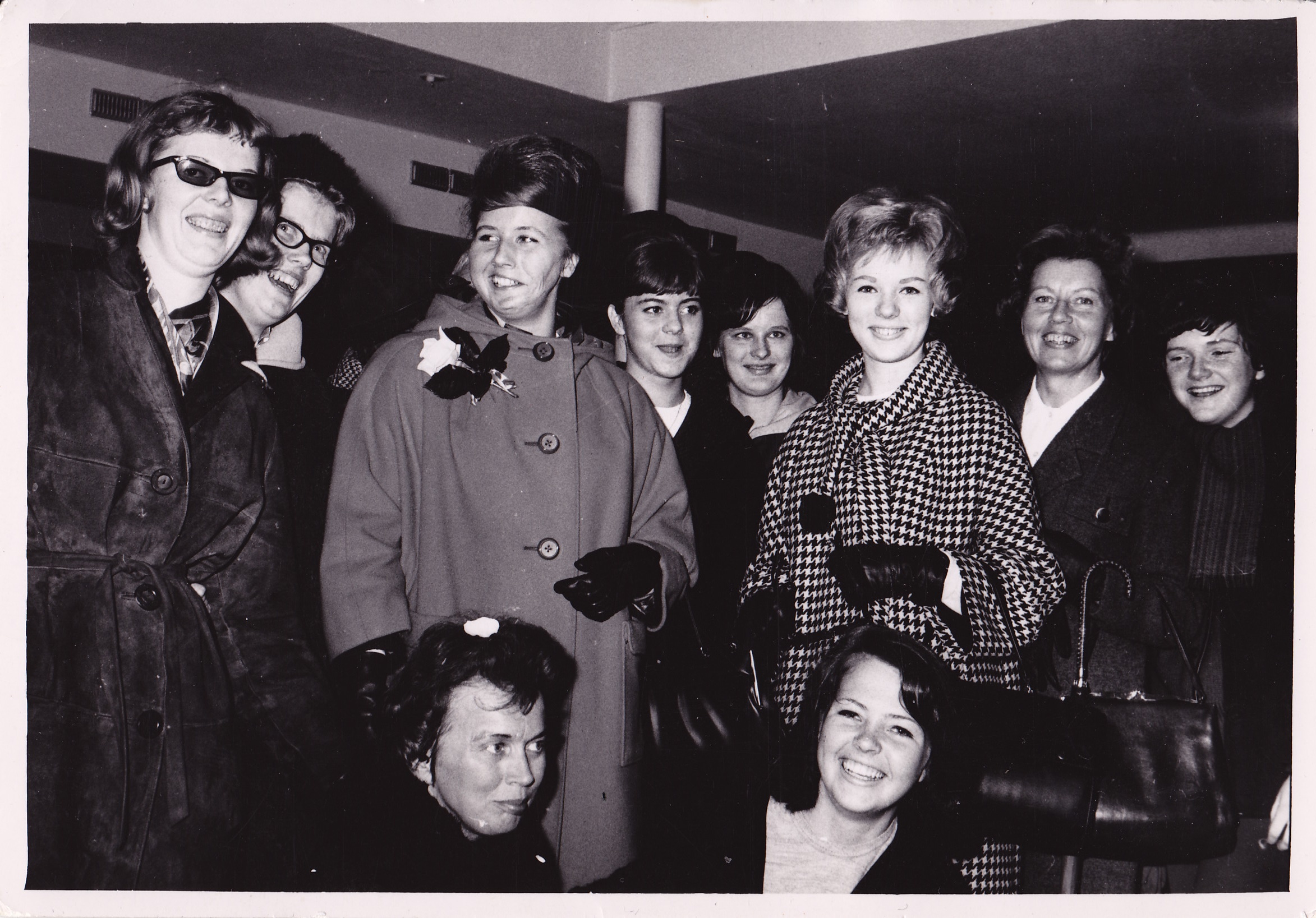 Lisbeth Pettersson, center left, with family and friends at the airport before leaving for America in 1964. Left to right: Lena Lindberg, Gull-brit Bjorklund, Lisbeth Pettersson, Ann-Marie Pettersson, a work friend, Margareta Johansson, Alice Pettersson, and former co-workers.