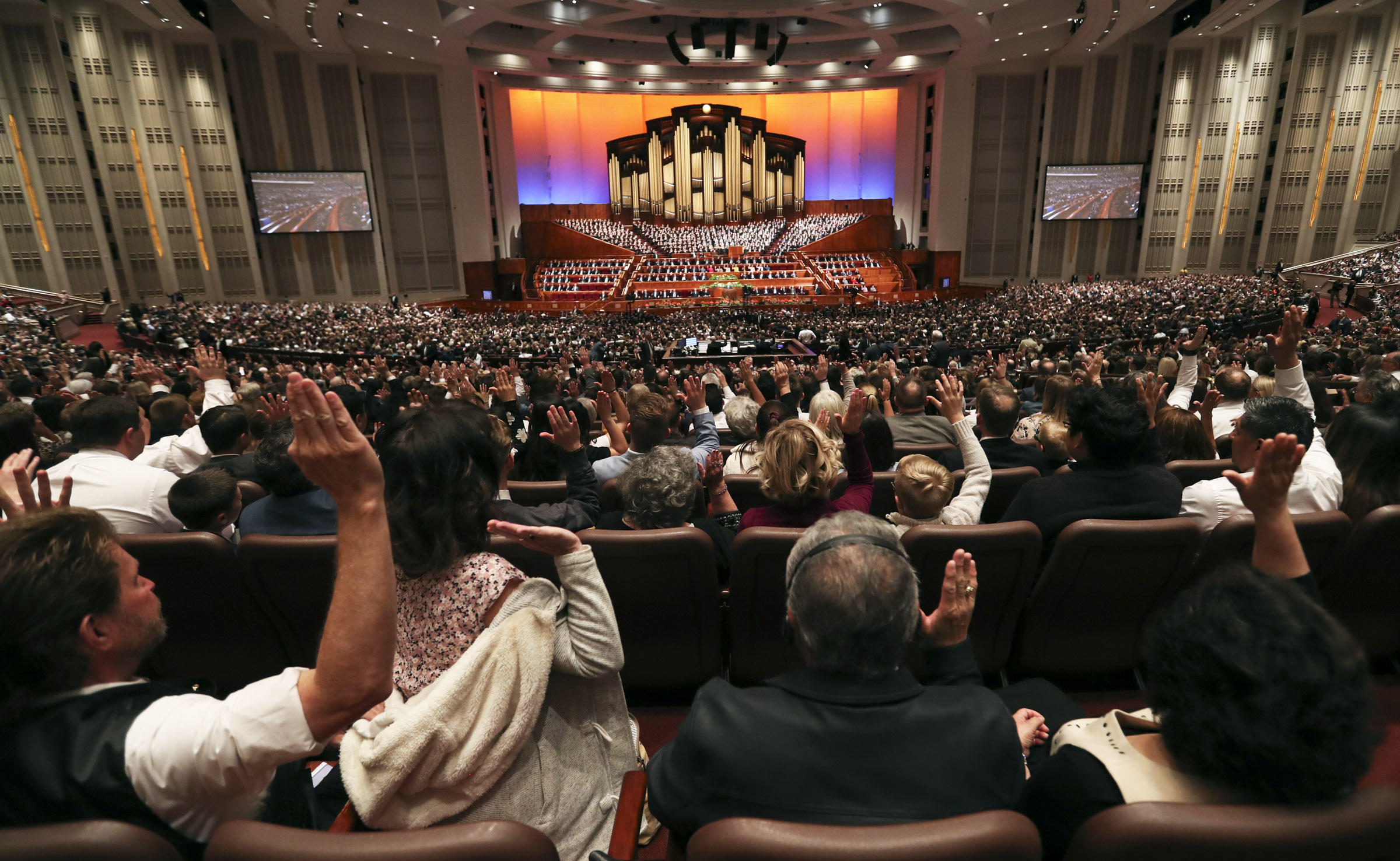 Attendees hold up their hands as they sustain church leaders during the Saturday afternoon session of the 189th Annual General Conference of The Church of Jesus Christ of Latter-day Saints in Salt Lake City on Saturday, April 6, 2019.