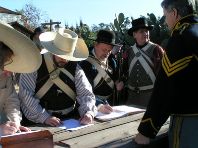 Mormon Battalion celebration participants in period uniforms enlist during a reenactment the mustering the battalion. The event was in San Diego Old Town.