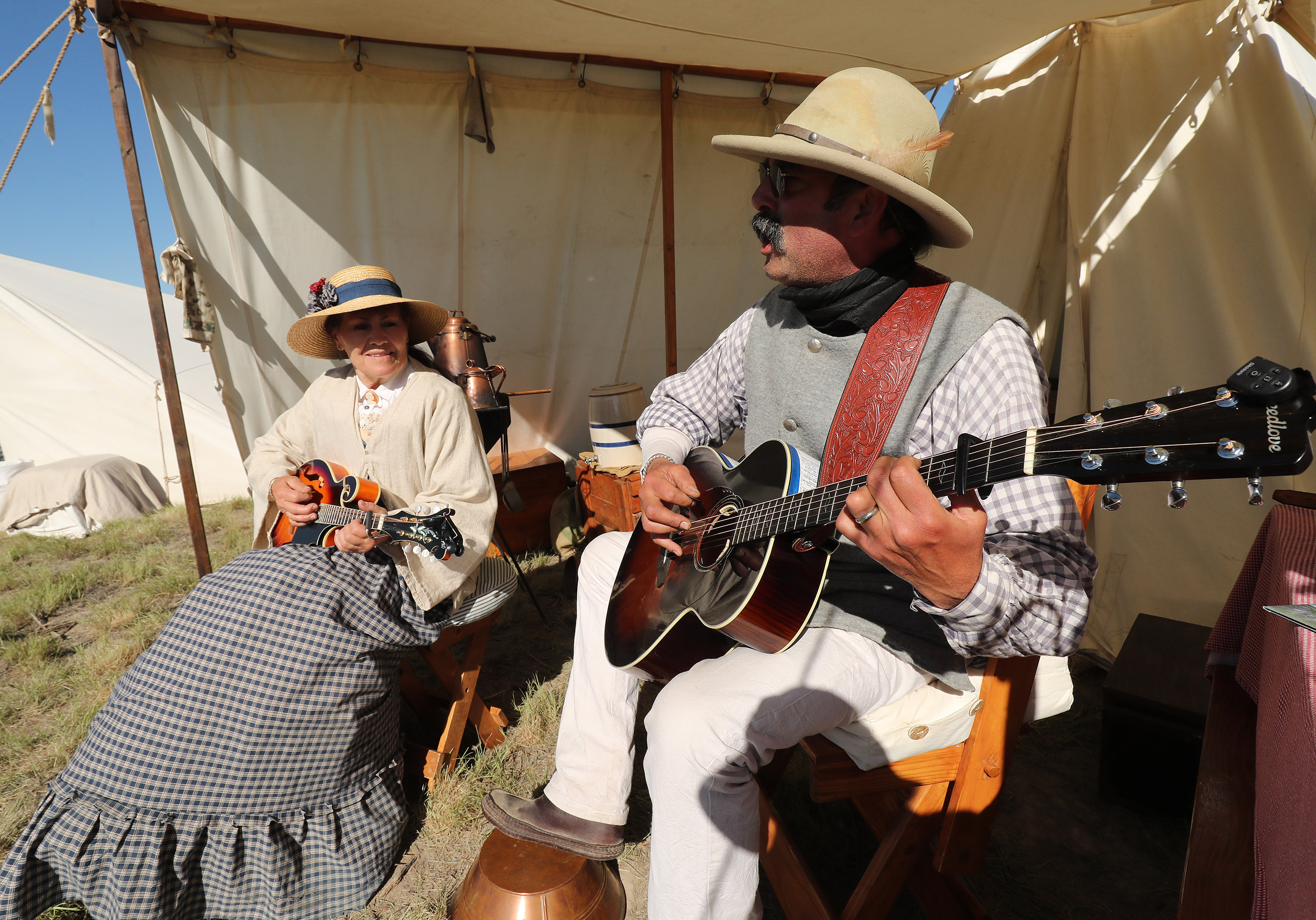 Mike Rudoff and Susy Epperson sing during the 150th anniversary celebration at the Golden Spike National Historical Park at Promontory Summit on Friday, May 10, 2019.