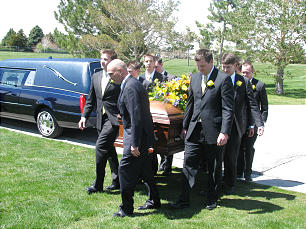 Funeral of Elder Jack H. Goaslind Jr. on May 2, 2011.Tuesday, May3, 2011. At cemetery, pall bearers carry casket from hearse to gravesite.