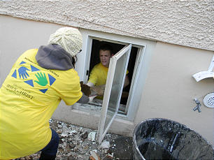 Missionaries joined local members and others to clear out a basement after Superstorm Sandy.Missionaries joined local members and others to clear out a basement after Superstorm Sandy.