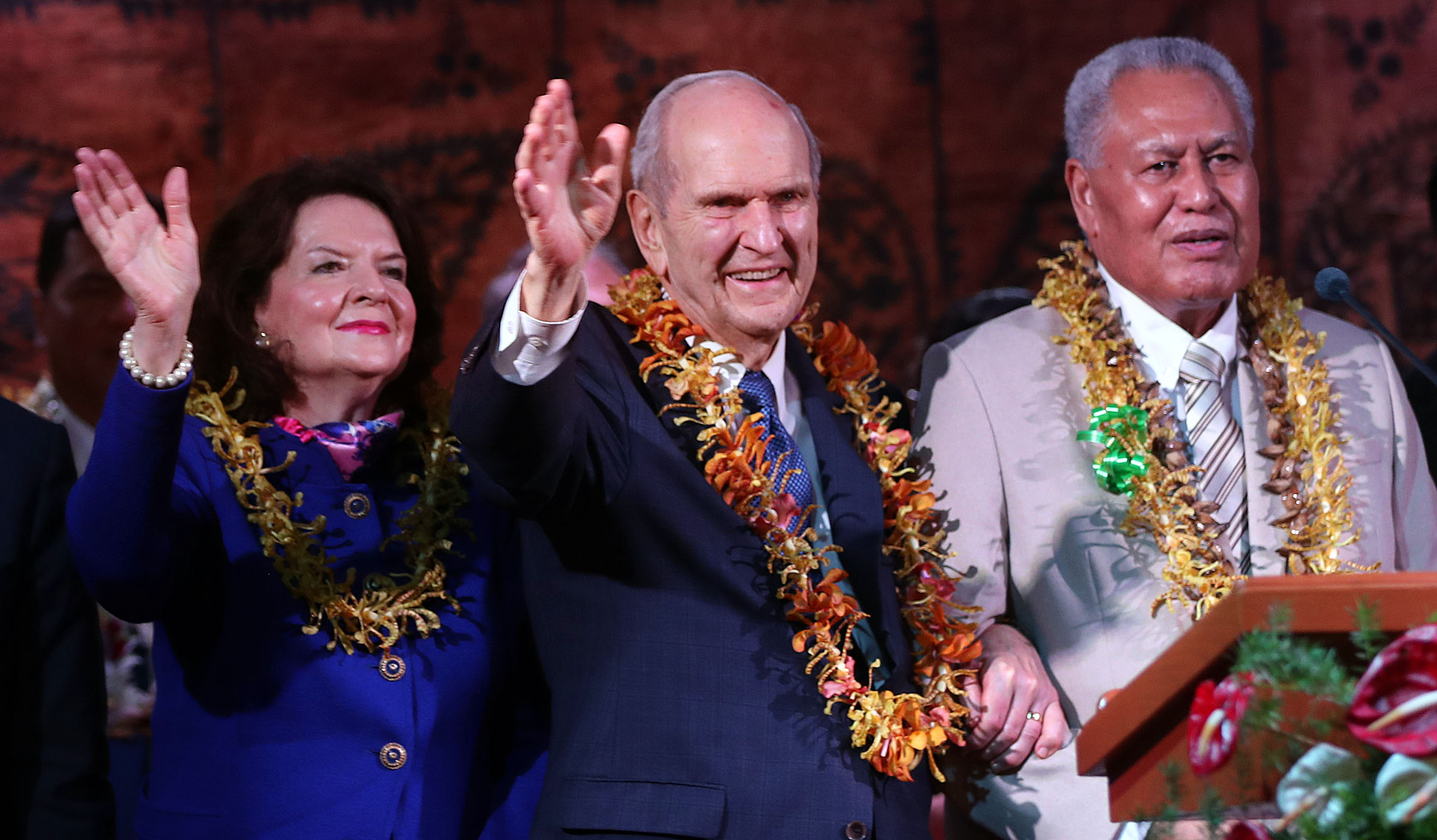President Russell M. Nelson of The Church of Jesus Christ of Latter-day Saints, center, and his wife, Sister Wendy Nelson, wave to those in attendance following a devotional in Apia, Samoa on Saturday, May 18, 2019. At right is His Highness Tuimaleali'ifano Va'aleto'a Eti Sualauvi II, Samoa Head of State.