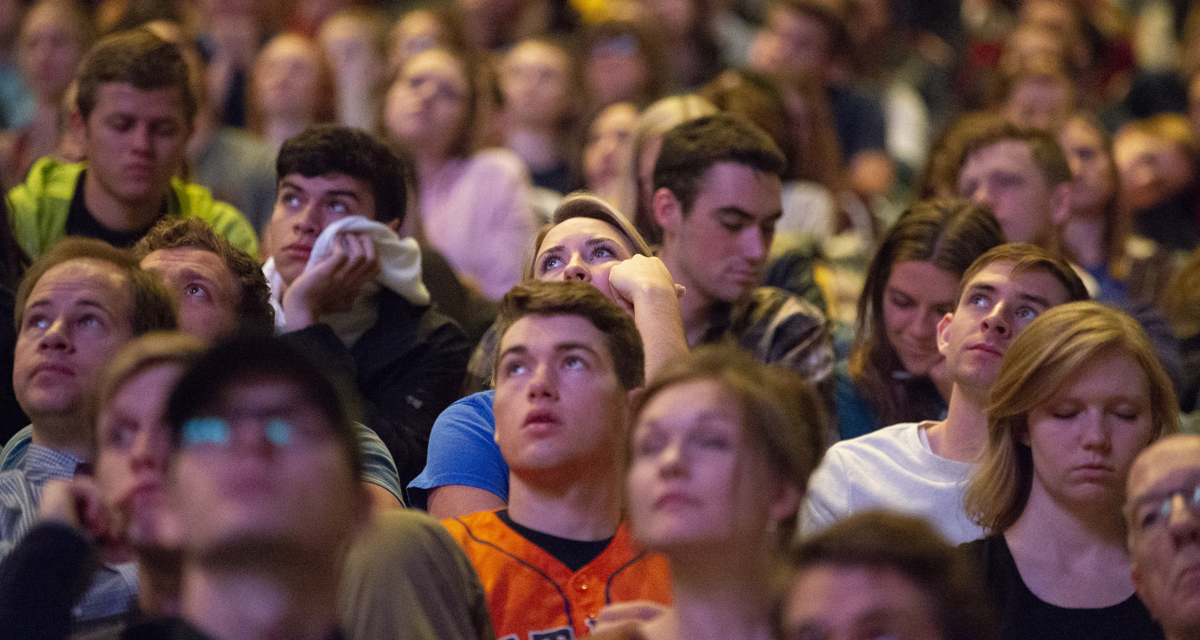 Crowd members watch and listen as Elder Gerrit W. Gong of the Quorum of the Twelve Apostles speaks at a BYU campus devotional on Tuesday, Oct. 16, 2018.