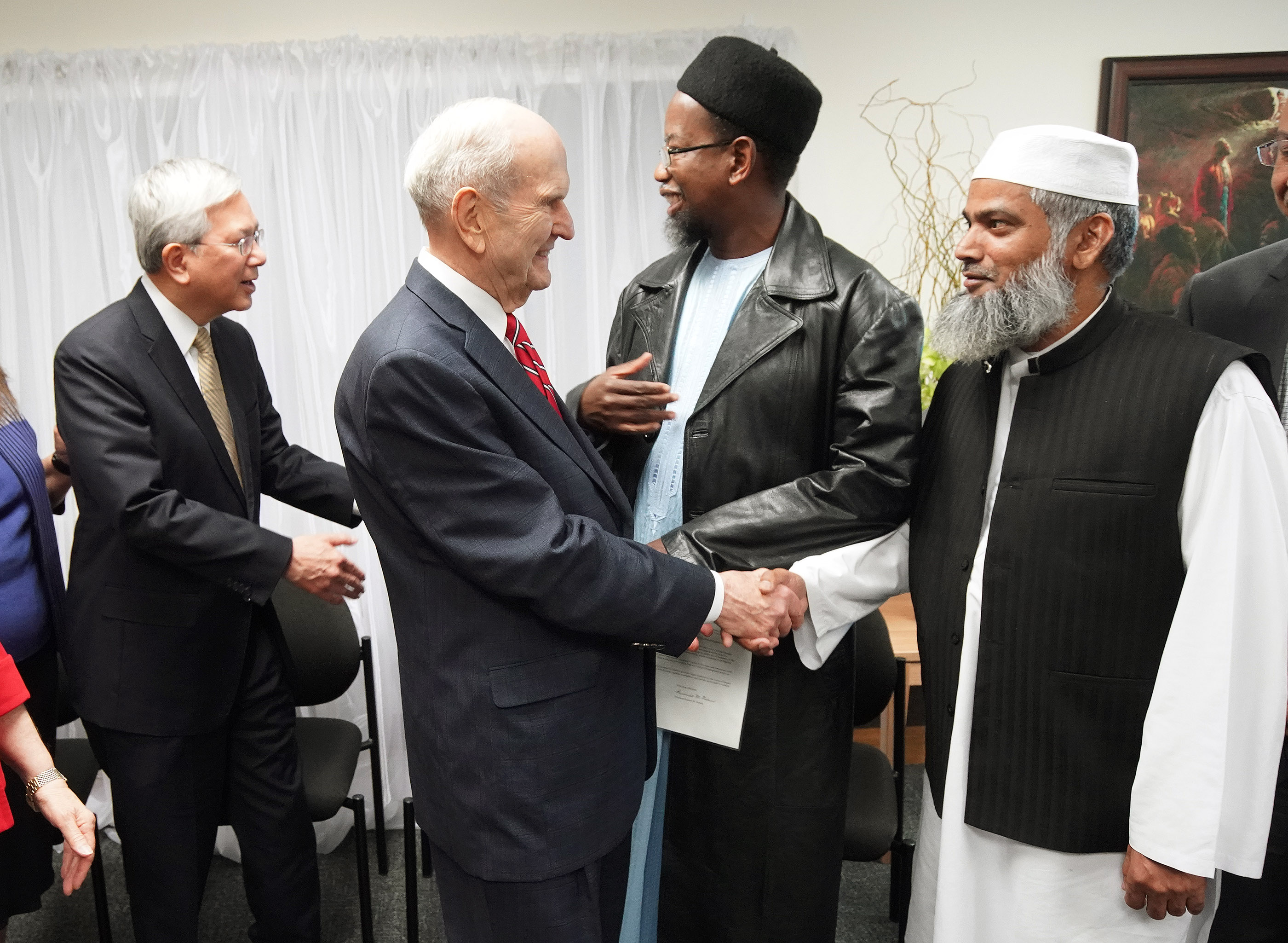 President Russell M. Nelson of The Church of Jesus Christ of Latter-day Saints greets Sheik Mohammad Amir and Elder Gerrit W. Gong, of The Church of Jesus Christ of Latter-day Saints' Quorum of the Twelve Apostles, shakes hands with Dr. Mustafa Farouk in Auckland, New Zealand on May 21, 2019.