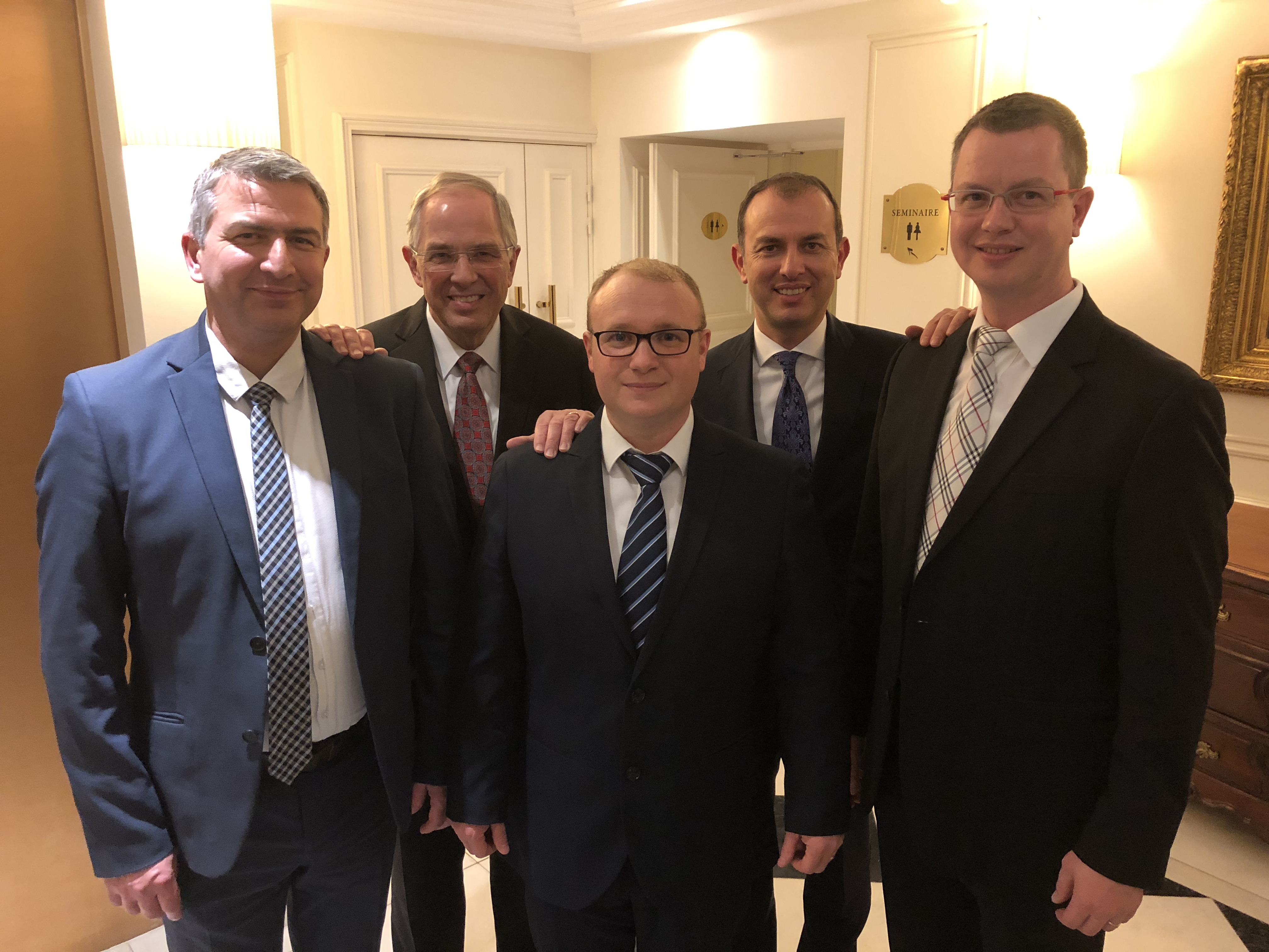 Elder Neil L. Andersen and Elder Matthieu Bennasar (back row) with the current presidency of the Bordeaux France Stake (front row, from left): President Yannick C. J. Leroy, first counselor; President Julien J. P. Raveneau, stake president; and President Aymeric E. R. Faucher, second counselor.
