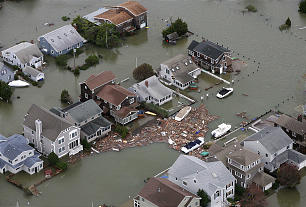 This photo made available by the New Jersey Governor's Office shows flooding and damage in Seaside, N.J. on Tuesday, Oct. 30, 2012 after superstorm Sandy made landfall in New Jersey Monday evening.