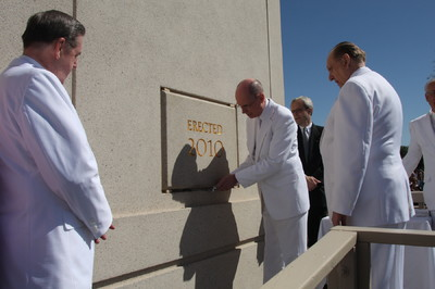 President Henry B. Eyring, first counselor in the First Presidency, applies mortar to The Gila Valley Arizona Temple cornerstone during ceremony May 23.