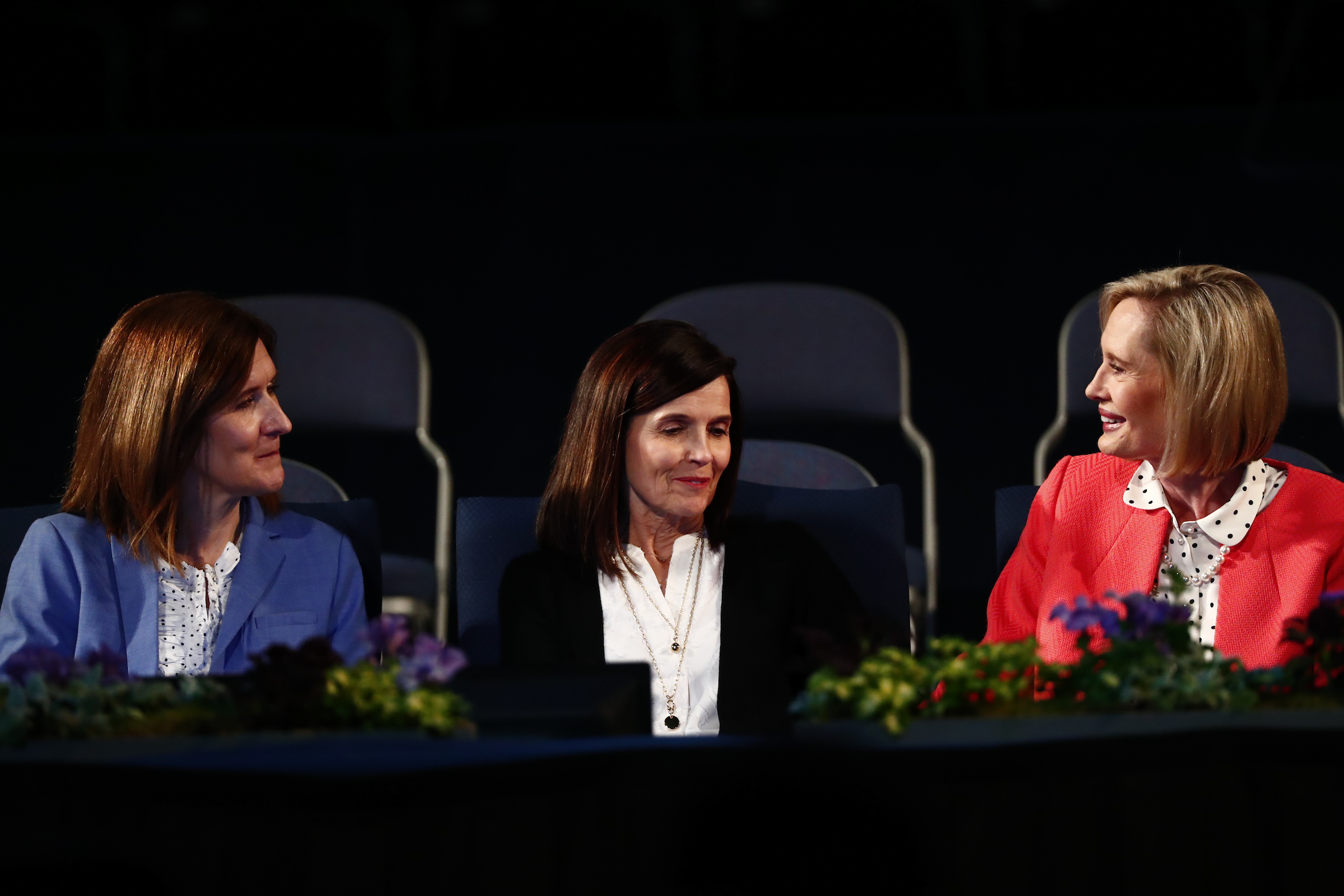 From left, Sister Michelle D. Craig, Sister Becky Craven, and Sister Bonnie H. Cordon of the Young Women general presidency sit on the stand prior to speaking in the Marriott Center during BYU Women's Conference on May 3, 2018.