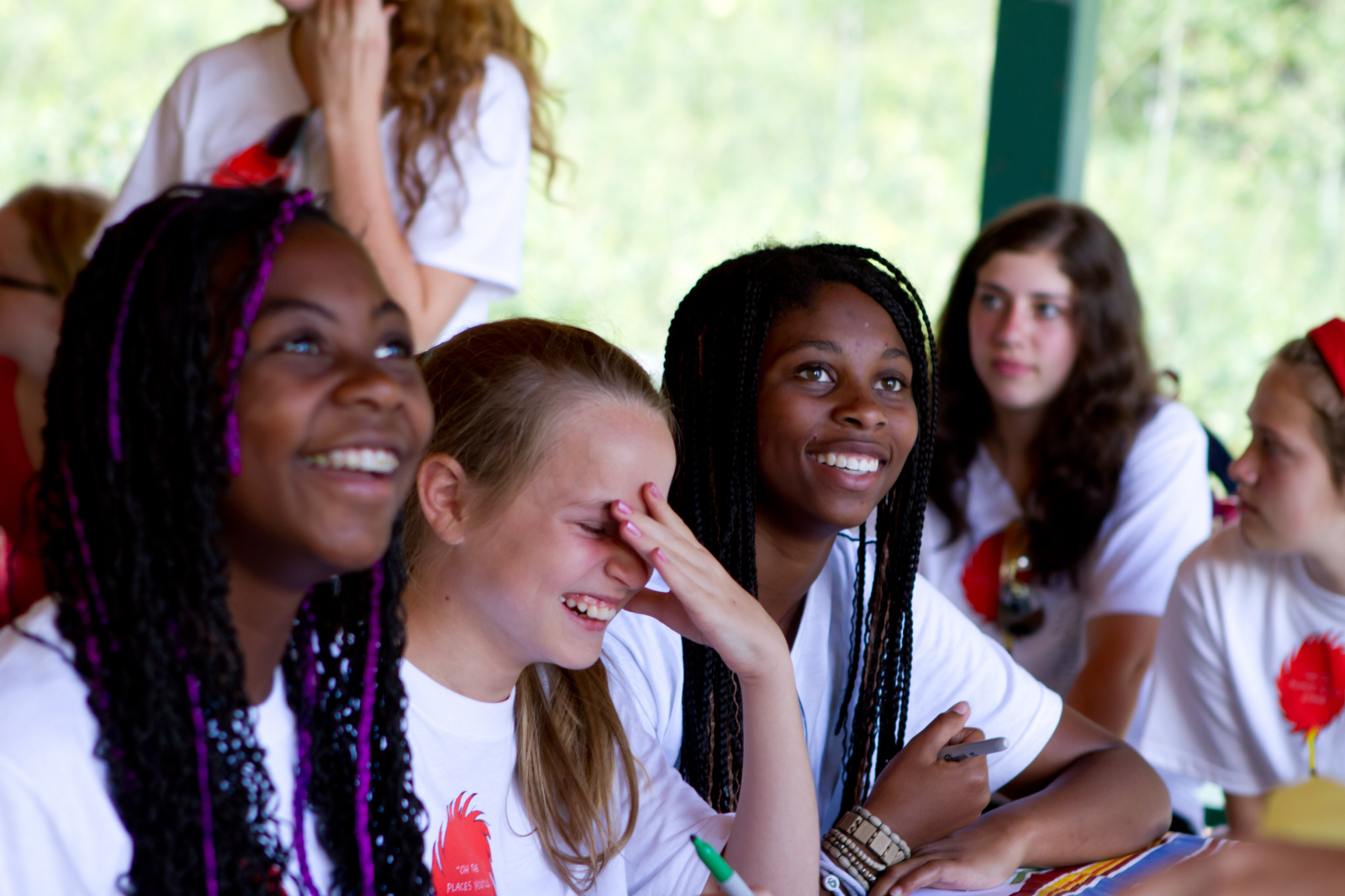 Young Women smile at camp. This year marks 150 years since the Young Ladies' Retrenchment Association, later renamed the Young Women Mutual Improvement Association, was organized by Brigham Young in the Lion House. This was the forerunner for today's Young Women program.
