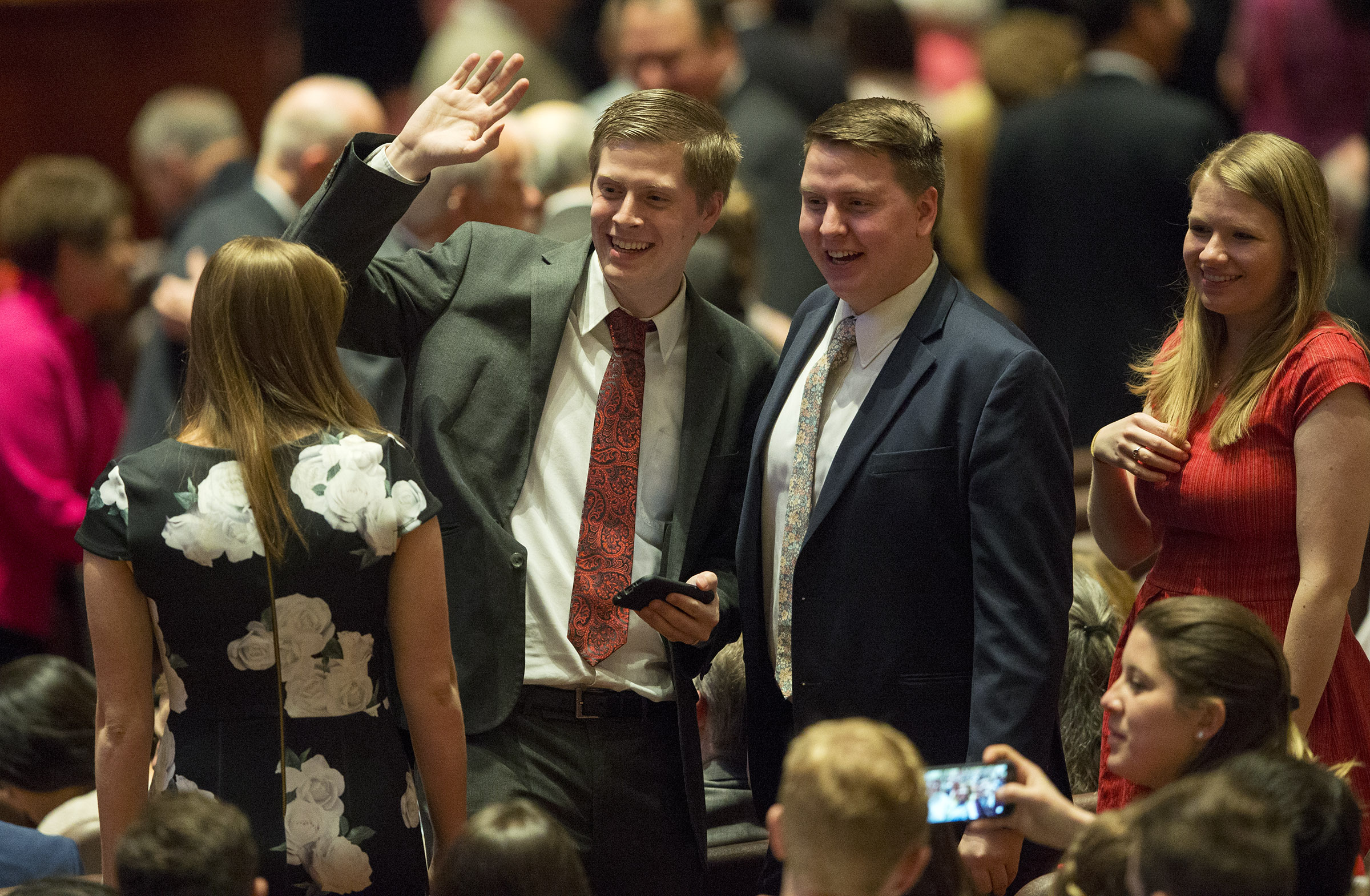 Conferencegoers wave to friends as they attend the Sunday afternoon session of the 188th Annual General Conference of The Church of Jesus Christ of Latter-day Saints, in the Conference Center in Salt Lake City on Sunday, April 1, 2018.
