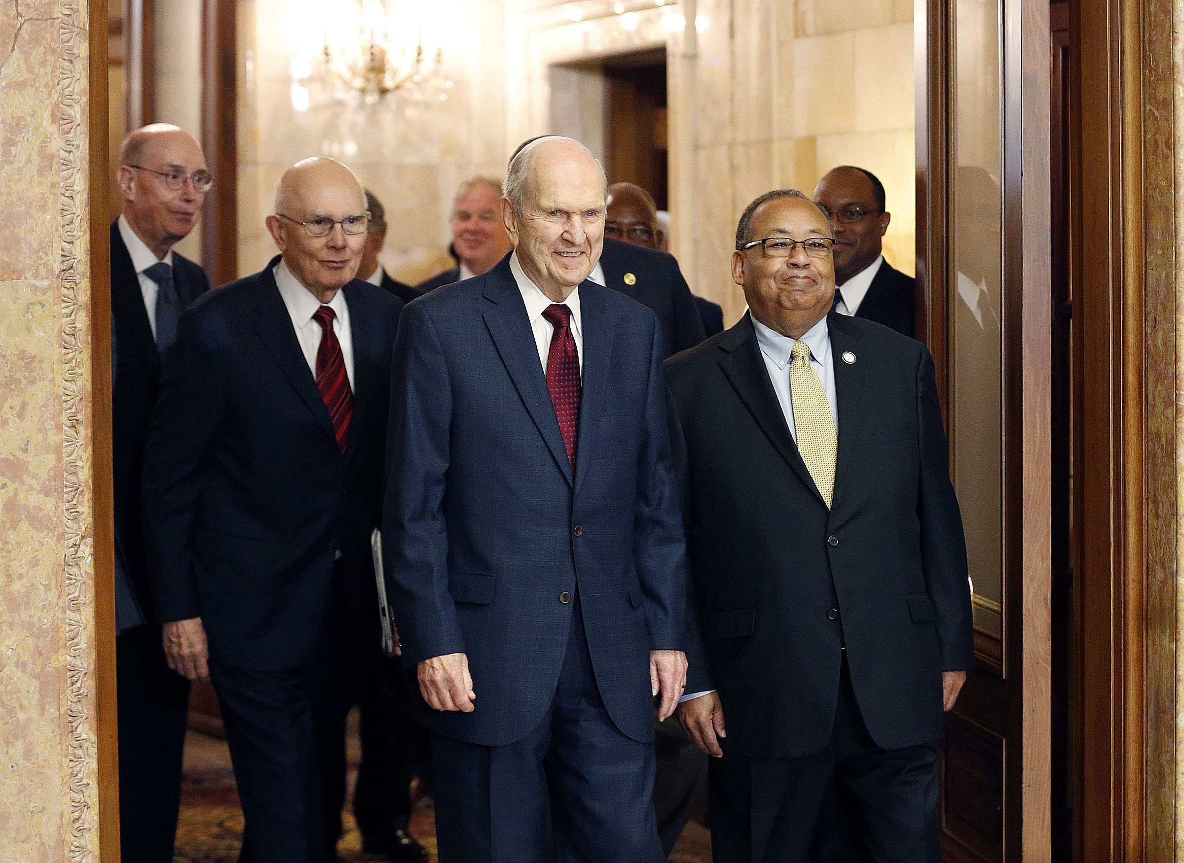 President Russell M. Nelson of The Church of Jesus Christ of Latter-day Saints walks to a press conference with Leon Russell, national chairman of the board of the NAACP, in the Church Administration Building in Salt Lake City on Thursday, May 17, 2018.