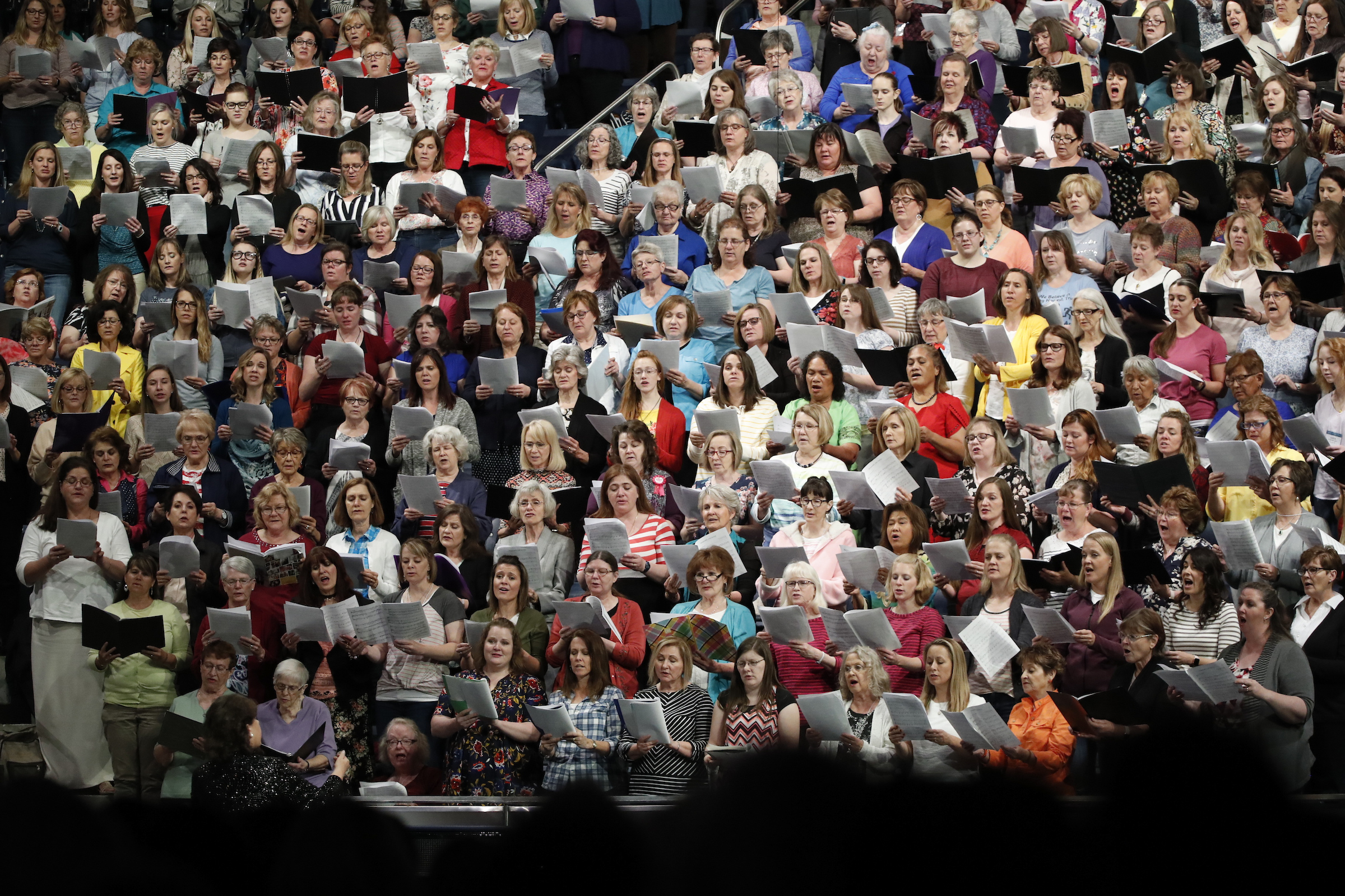 "An ""instant choir"" performs during one of the keynote sessions of the BYU Women's Conference on May 3."
