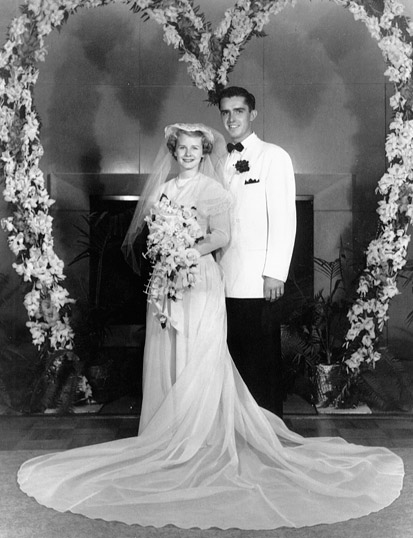 M. Russell Ballard and Barbara Bowen Ballard smile in an official wedding photo from 1951.