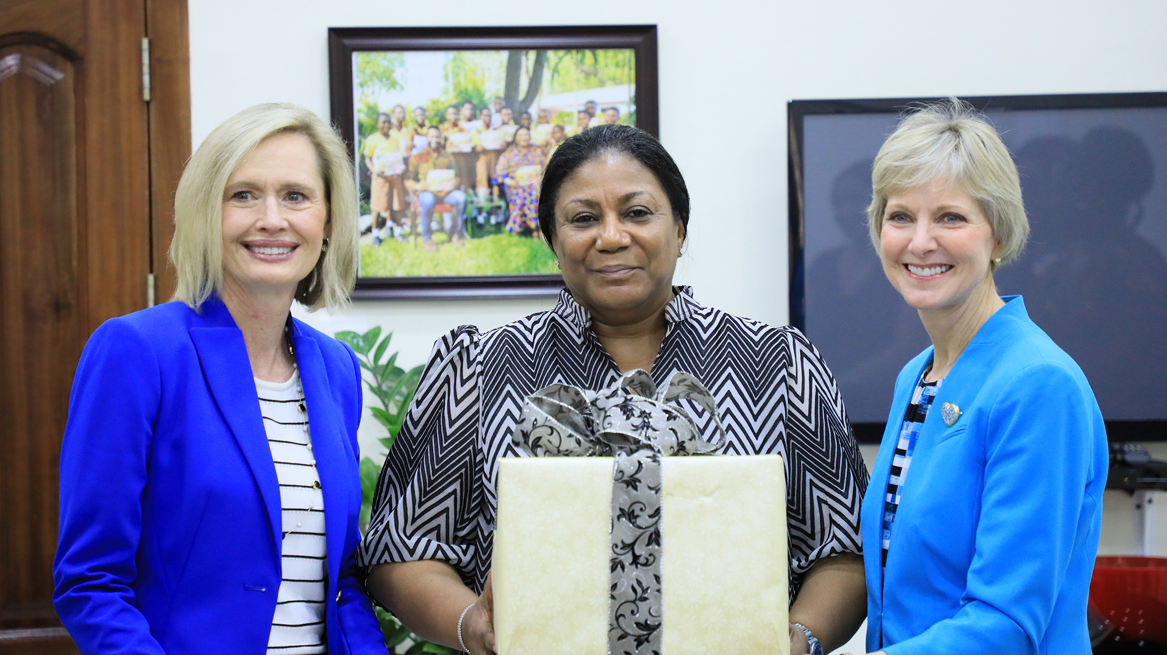 Sister Bonnie H. Cordon, left, and Sister Jean B. Bingham, right, visit Rebecca Naa Okaikor Akufo-Addo, the first lady of the Republic of Ghana, at North Ridge in Accra, Friday, March 1, 2019. The Latter-day Saint leaders presented Her Excellency with a card and gift to acknowledge her upcoming birthday on March 12.