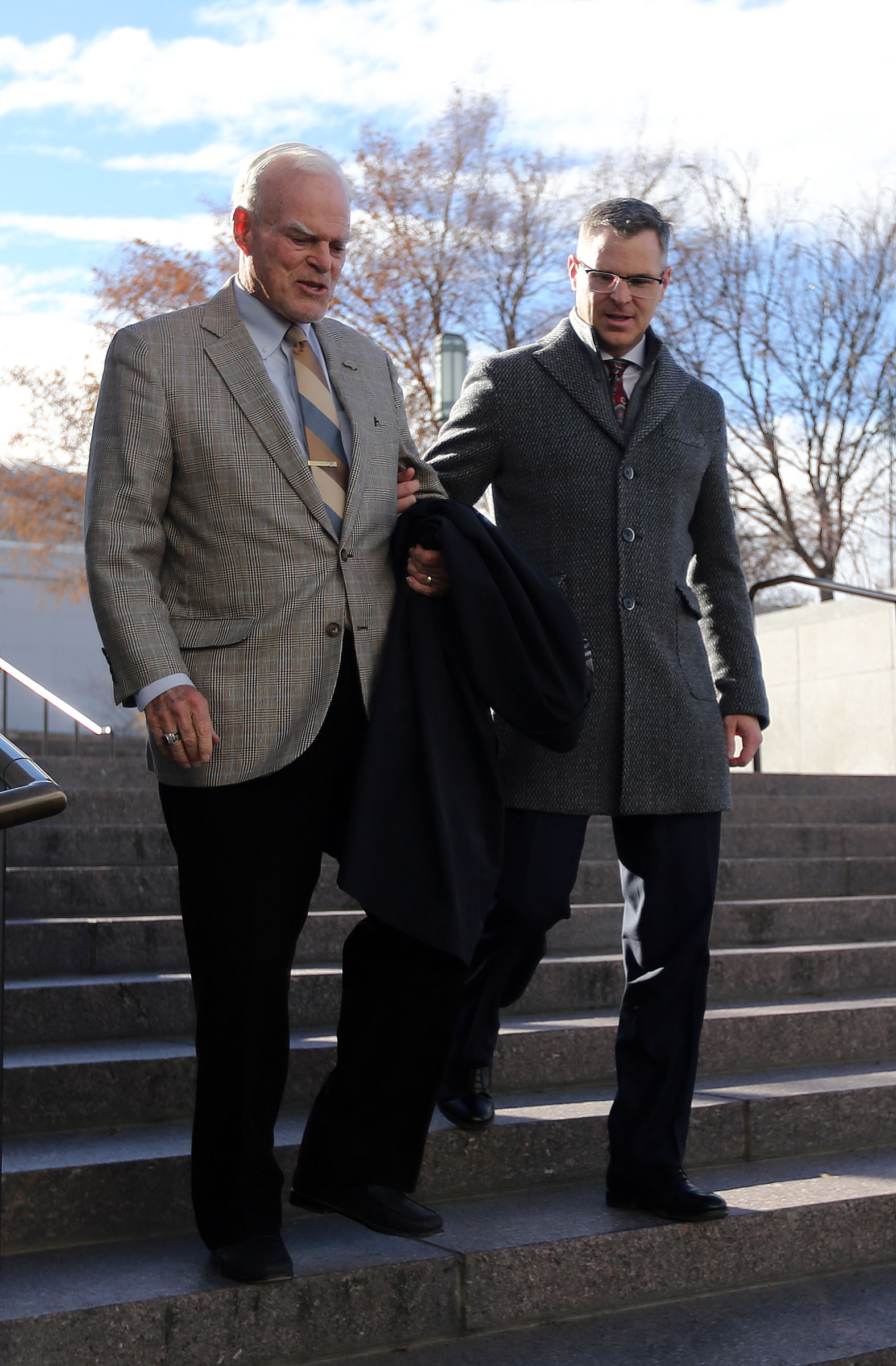 Spencer S. Eccles and Spencer P. Eccles arrive for President Thomas S. Monson's funeral at the Conference Center in Salt Lake City on Friday, Jan. 12, 2018.