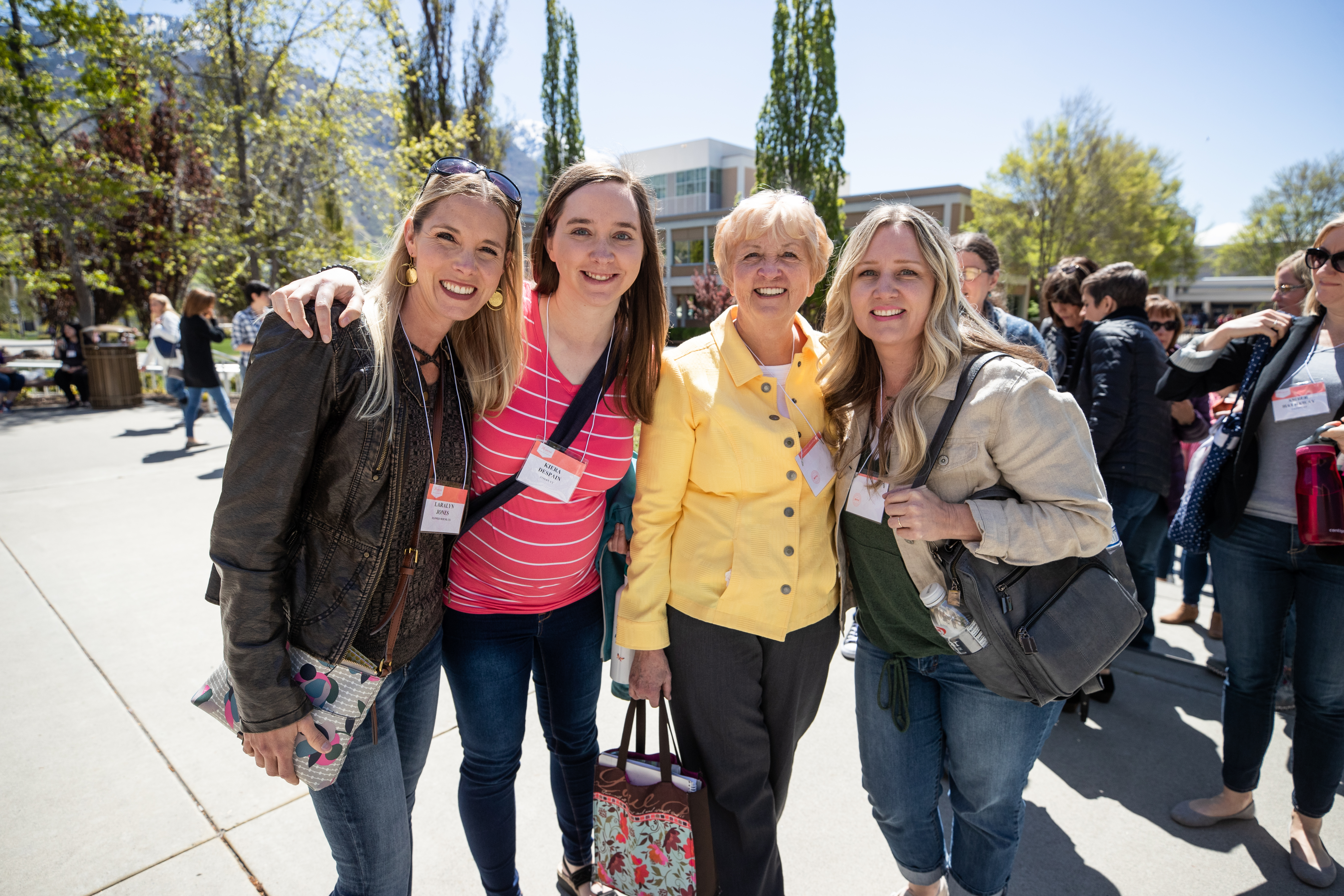 Women gather outside the Marriott Center as they head to their classes during the 2019 Women's Conference, on May 2, 2019.