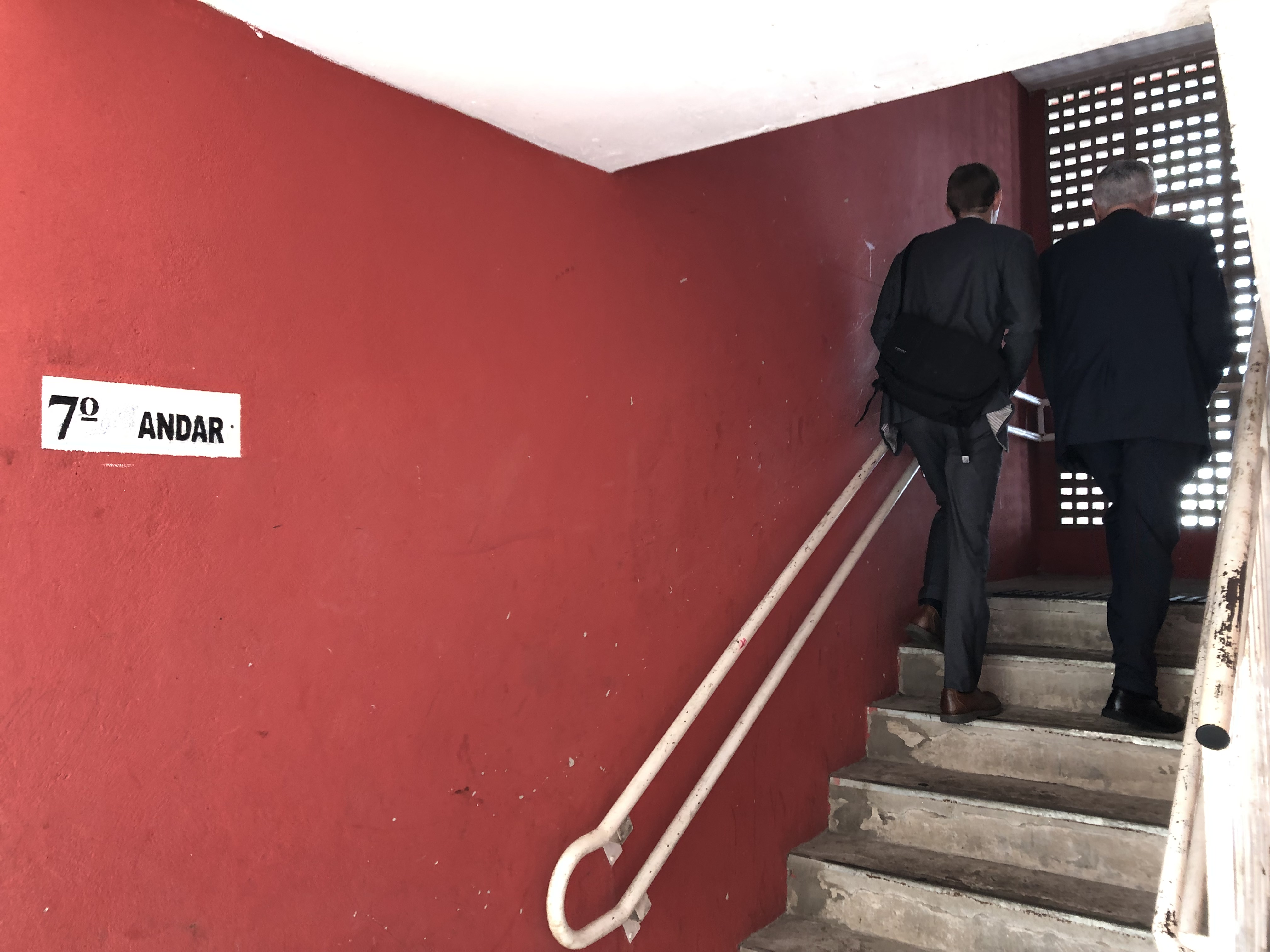 Elder Dieter F. Uchtdorf, right, of the Quorum of the Twelve Apostles, climbs the stairs between the seventh and eighth floors of an apartment building in Sao Paulo, Brazil, as he goes out teaching with a companionship of full-time missionaries.
