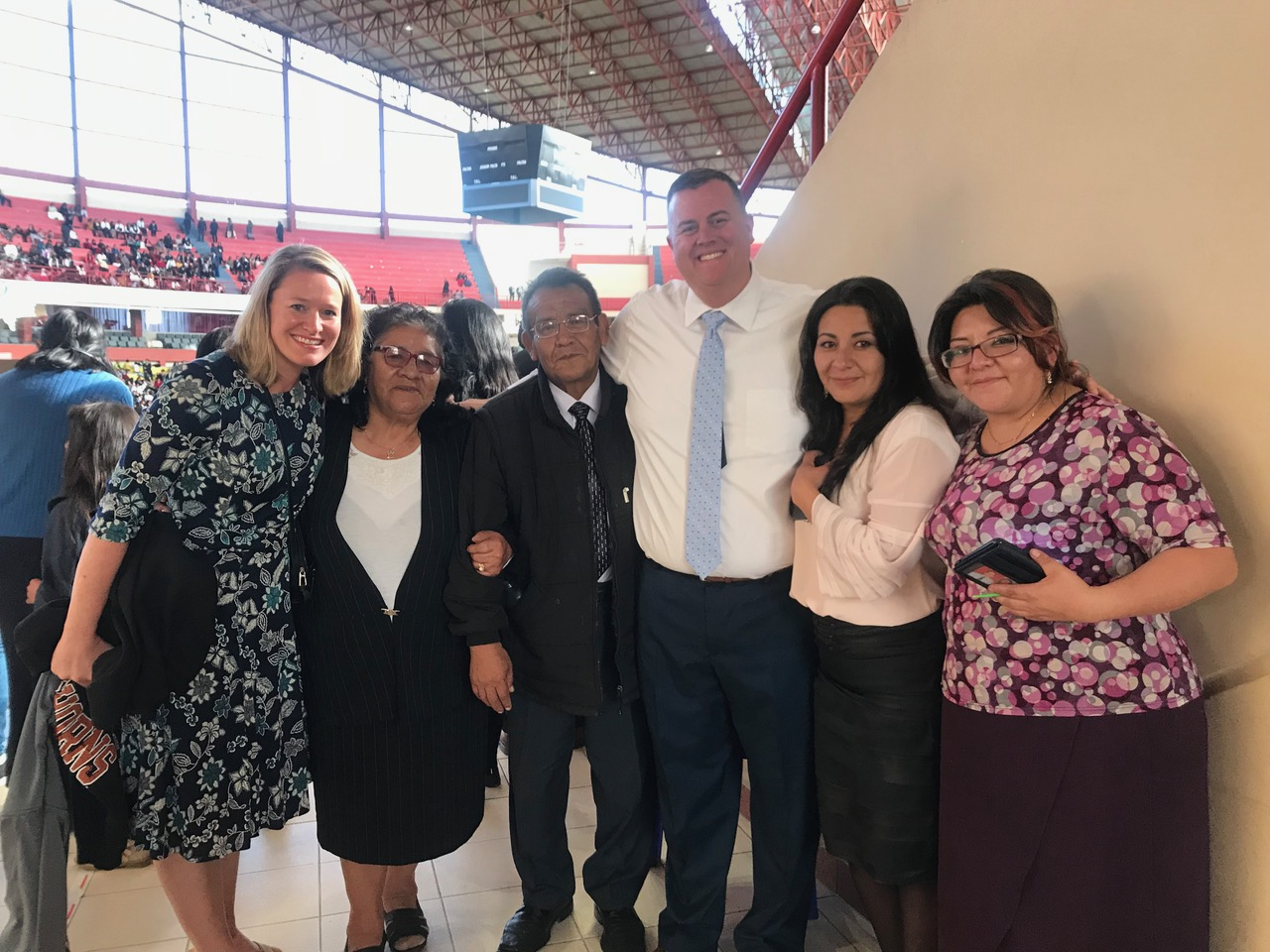 Celestino Orellana and Tommy Upshaw (center) with their families when they reunited at the Polideportivo Heroes de Octubre in El Alto on Sunday, Oct. 21 at the fireside where President Nelson spoke.