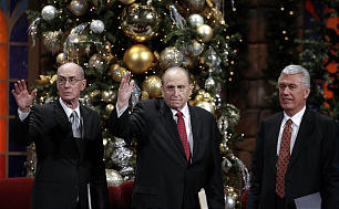 President Henry B. Eyring, left, President Thomas S. Monson and President Dieter F. Uchtdorf wave to the congregation after the annual First Presidency Devotional.