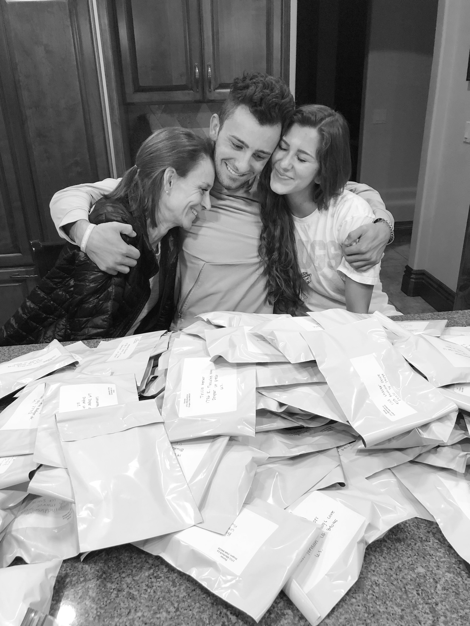 Annette Ferran (left) with her two youngest children after assembling the wristbands they used to raise donations for their October service project.