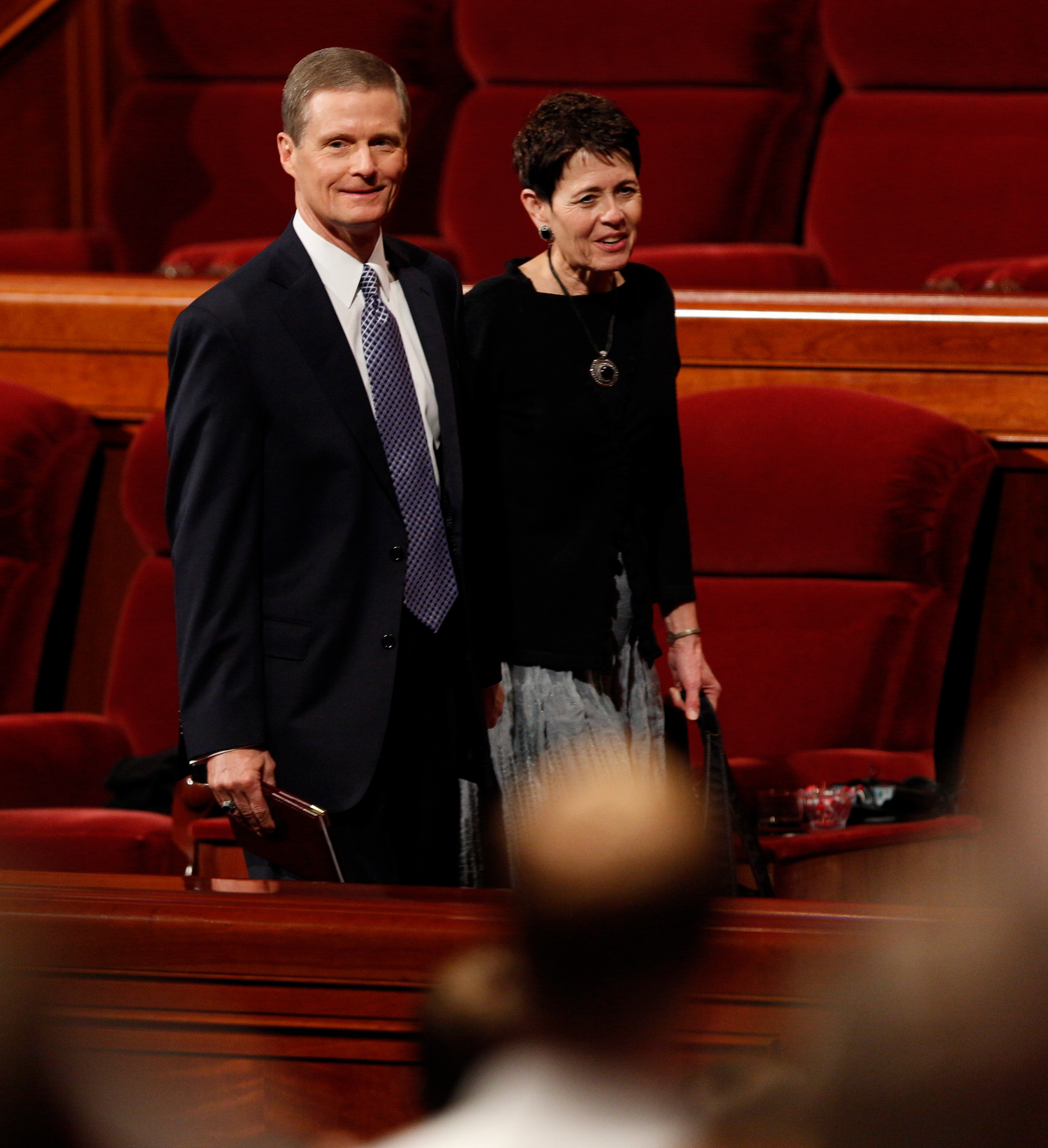 Elder David A. Bednar and his wife, Sister Susan Bednar, leave the Conference Center podium after a general conference session.