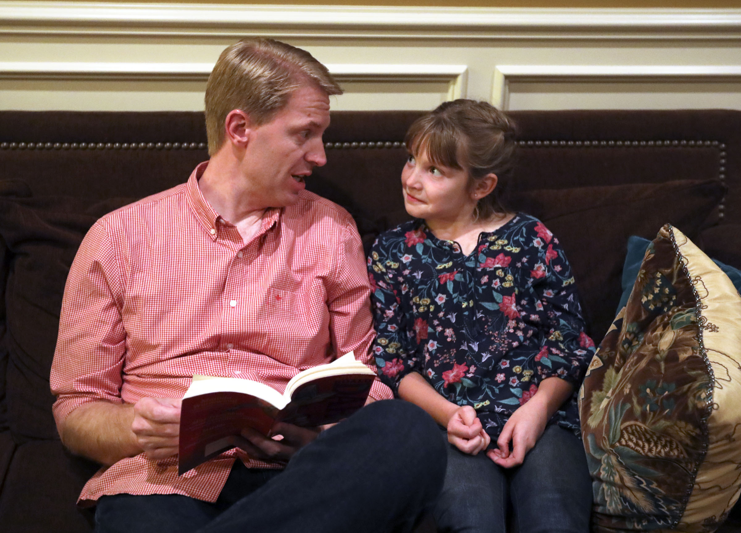 Justin Allen reads to his daughter Emilia Allen at home in Renton, Wash., on Friday, Sept. 14, 2018.