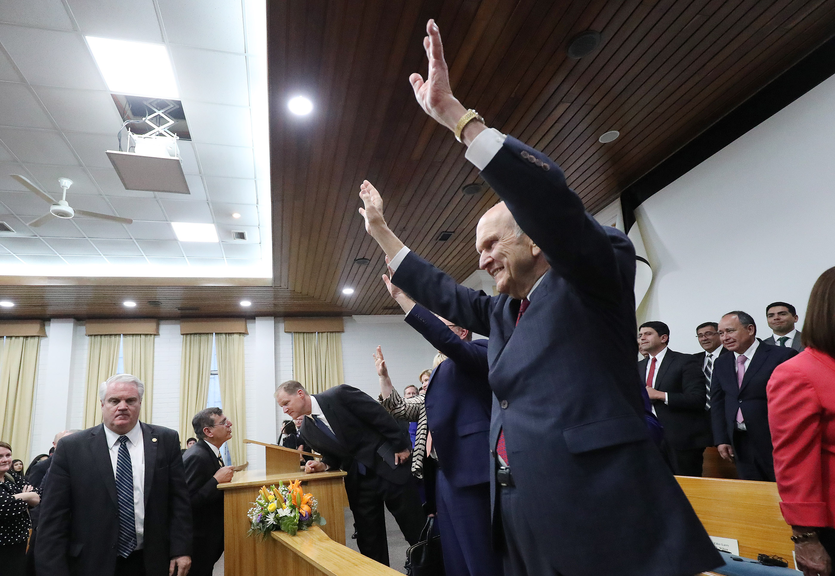 President Russell M. Nelson of The Church of Jesus Christ of Latter-day Saints waves to attendees after a youth devotional in Concepcion, Chile on Saturday, Oct. 27, 2018.