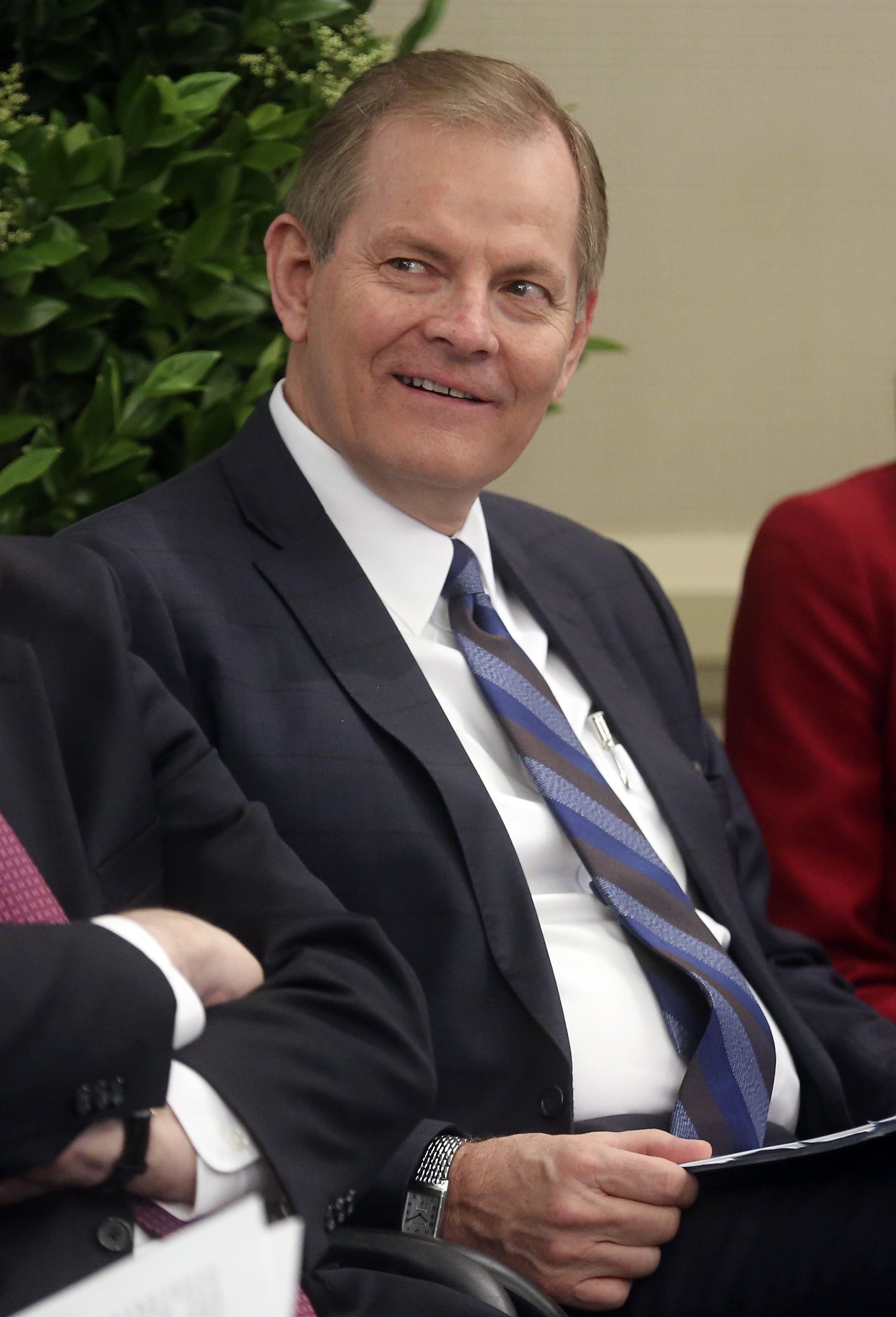Elder Gary E. Stevenson, of the Quorum of the Twelve Apostles, listens to a speaker during news conference held for the newly renovated Oakland California Temple, of The Church of Jesus Christ of Latter-day Saints, in the temple Visitors' Center in Oakland, Calif., on Monday, May 6, 2019.