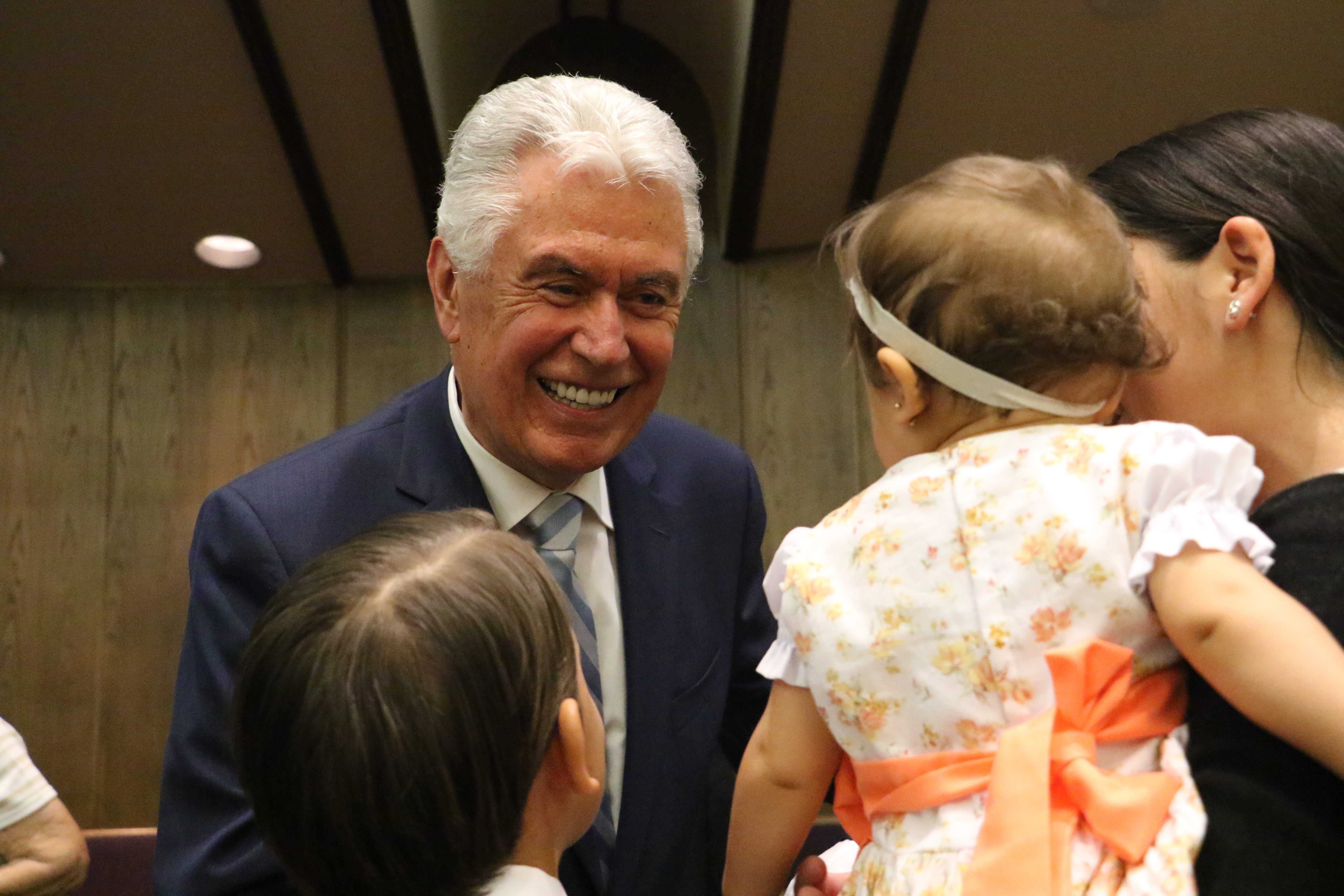 Elder Dieter F. Uchtdorf of the Quorum of the Twelve Apostles greets members following the German Speaking Ward's final sacrament meeting on July 14, 2019, in Salt Lake City. He spent over an hour shaking the hands of attendees.