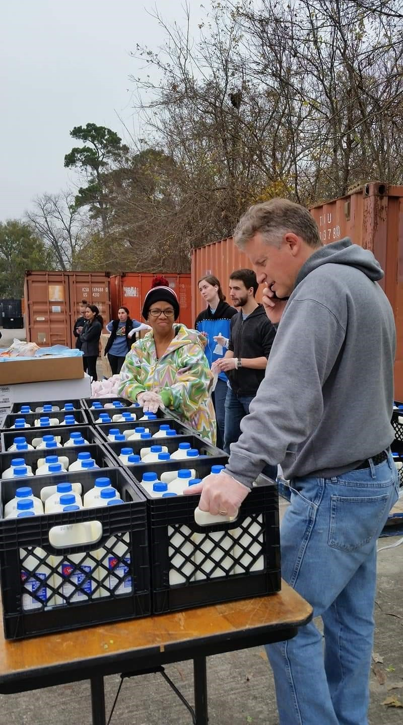 Elder Kory Sellers participates in a food distribution project.