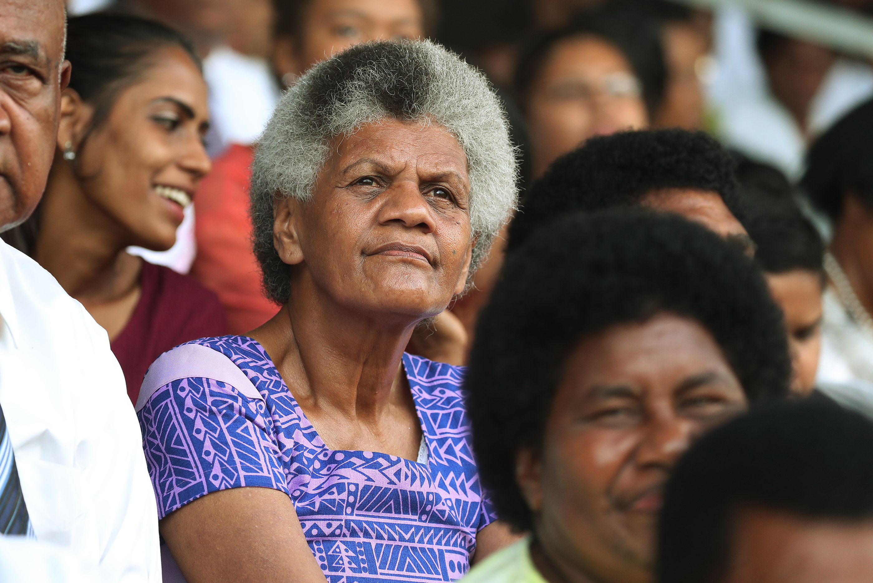 An attendee listens during a devotional at Ratu Cakobau Park stadium in Nausori, Fiji, on May 22, 2019.